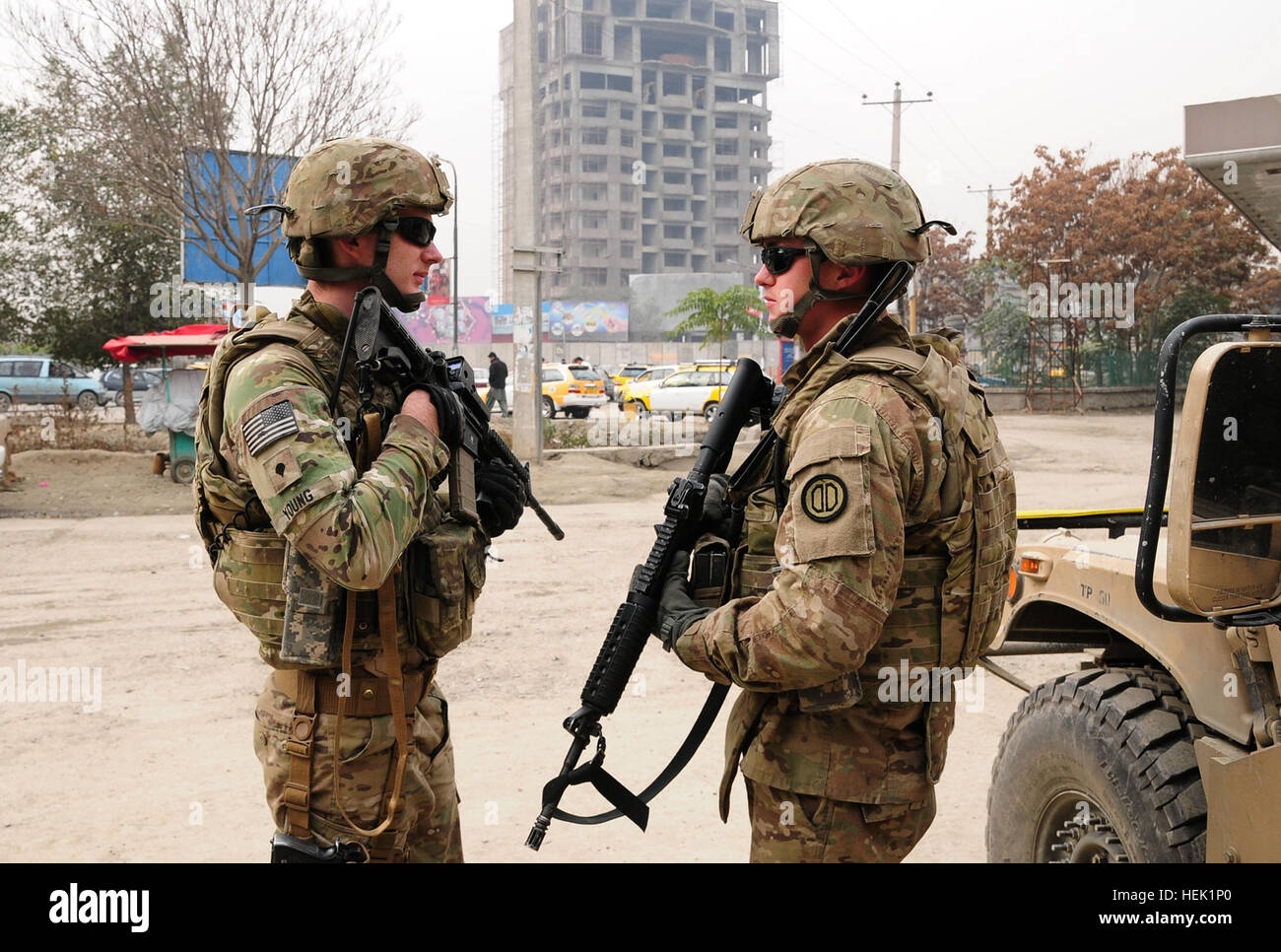 Task Force Spartan 3 soldier Army Spc. Daniel Fowler (right) provides security for his team while Afghan National - Stock Image