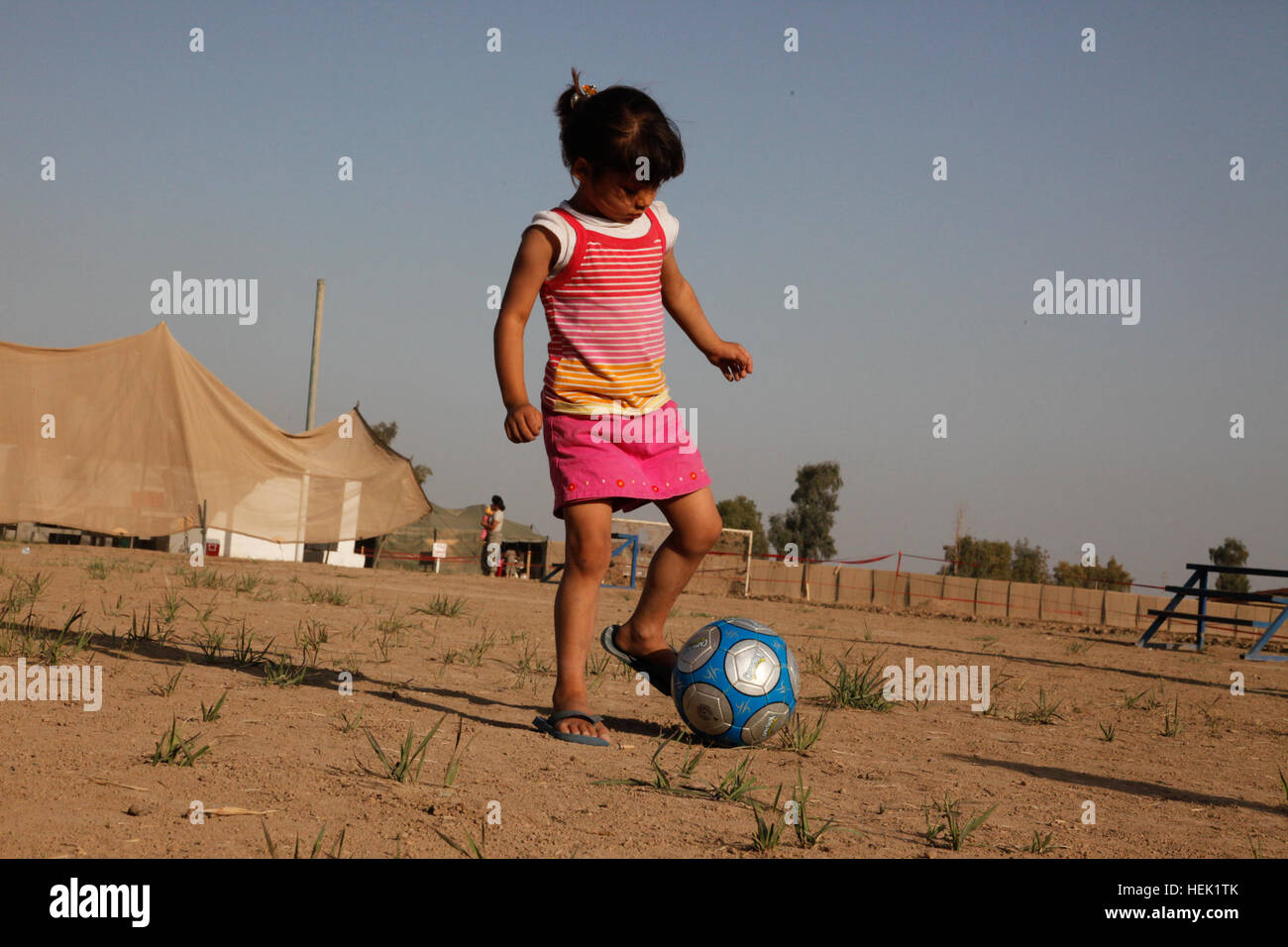 A young girl participates in the two-day, semi-annual scouting camp-out where the children are taught a wide variety - Stock Image
