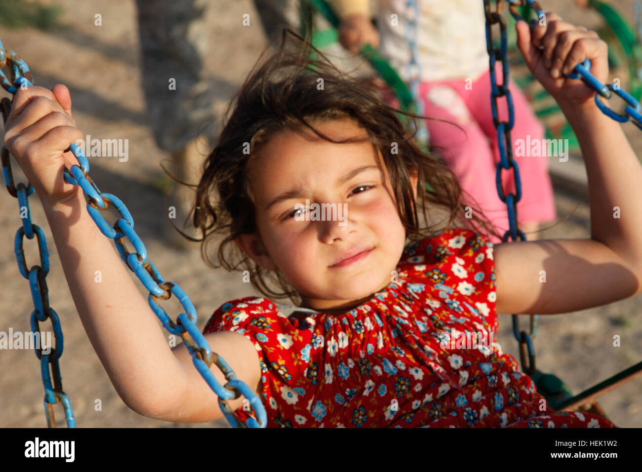 A young girl swings during a two-day, semi-annual scouting camp-out where children are taught a wide variety of - Stock Image