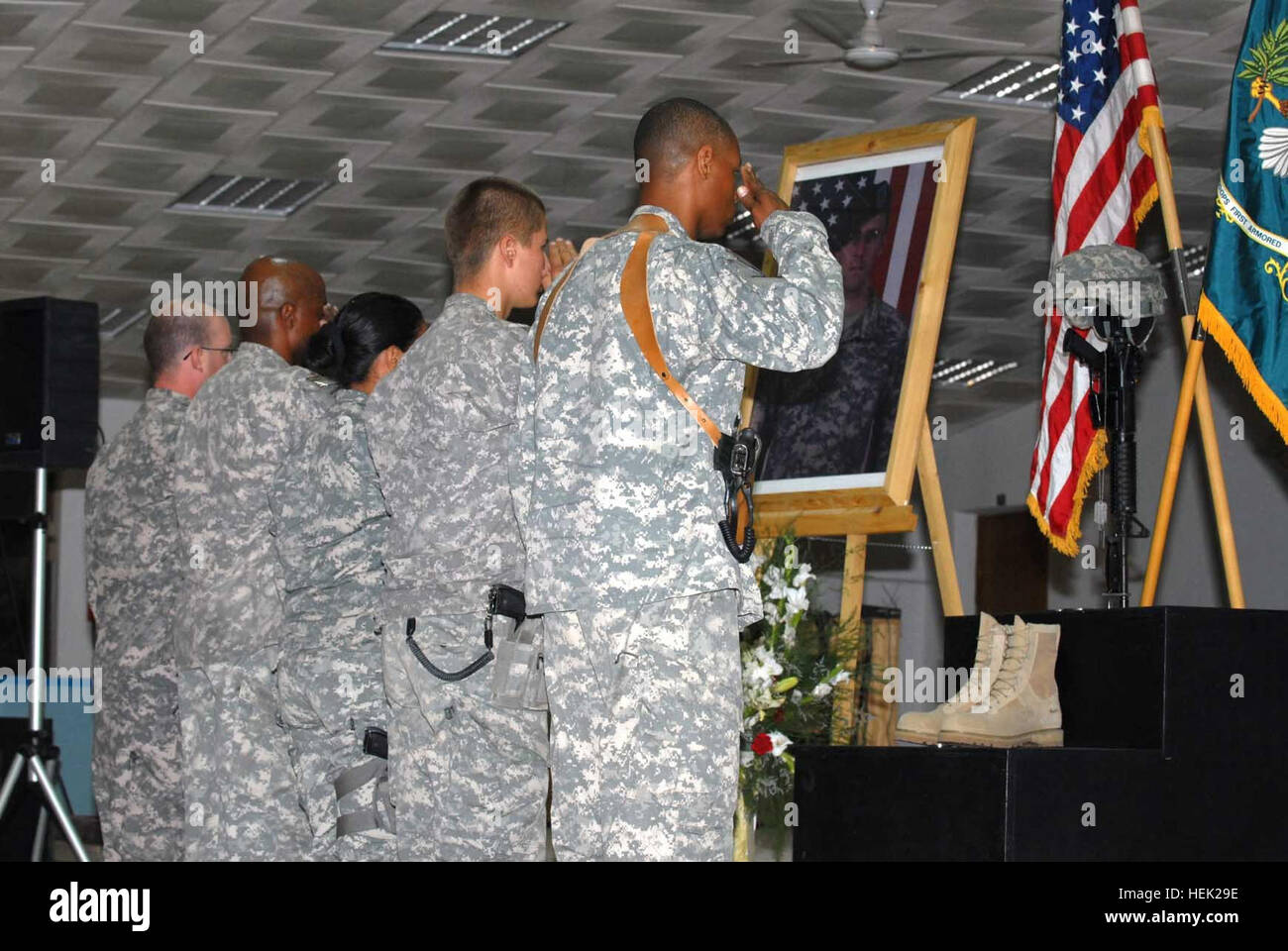 Soldiers of Special Troops Battalion, 4th Brigade Combat Team, 1st Armored Division, salute a display dedicated Stock Photo