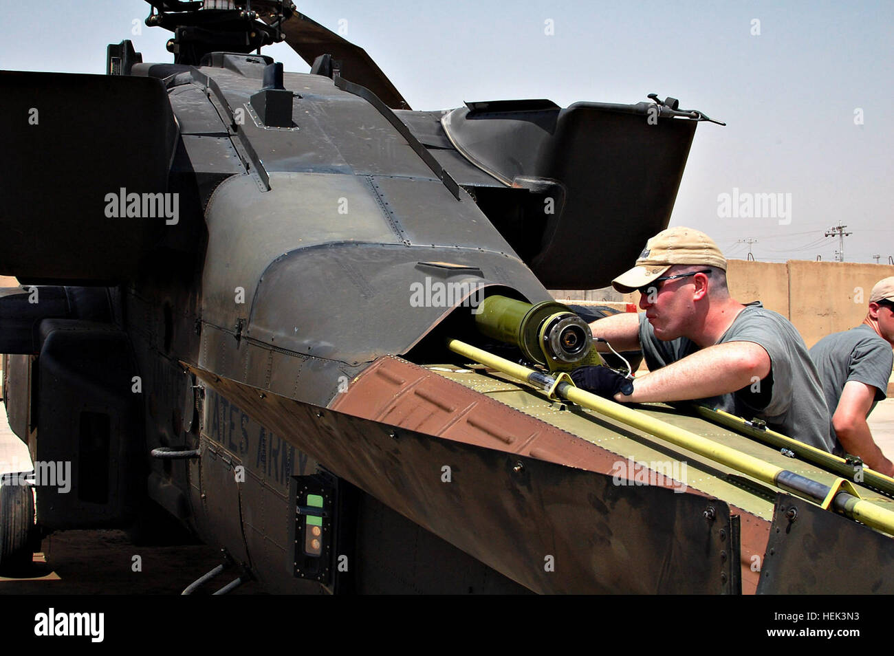 Sgt. Dustin Esenwein, an Apache repairer and native of Spring Hill, Fla., maintains a helicopter at Camp Taji May - Stock Image