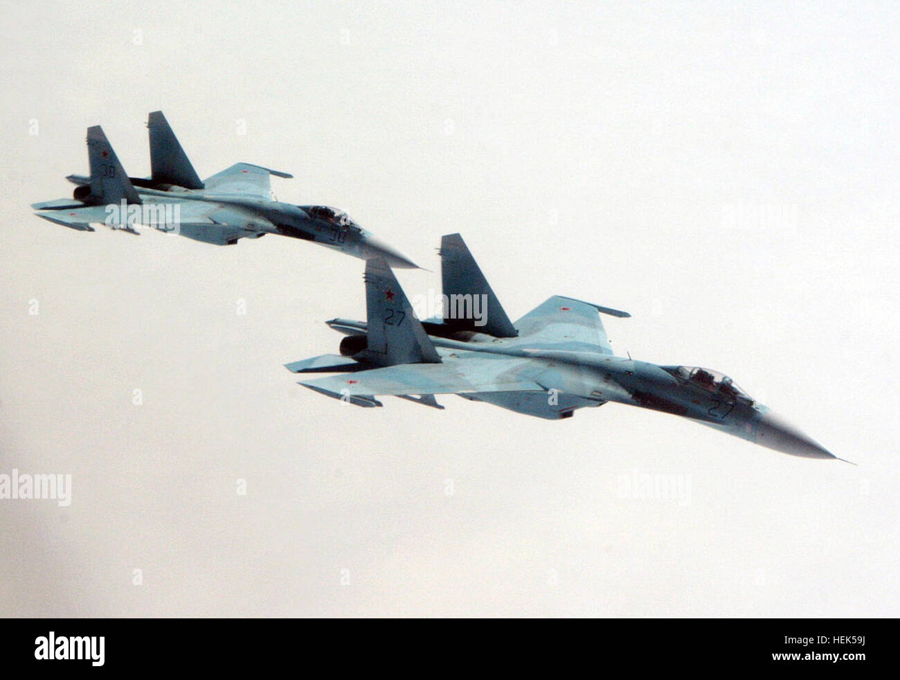 A pair of Russian Air Force Su-27 Flanker aircraft intercept a simulated hijacked Gulfstream G-400 (G-IV) aircraft - Stock Image