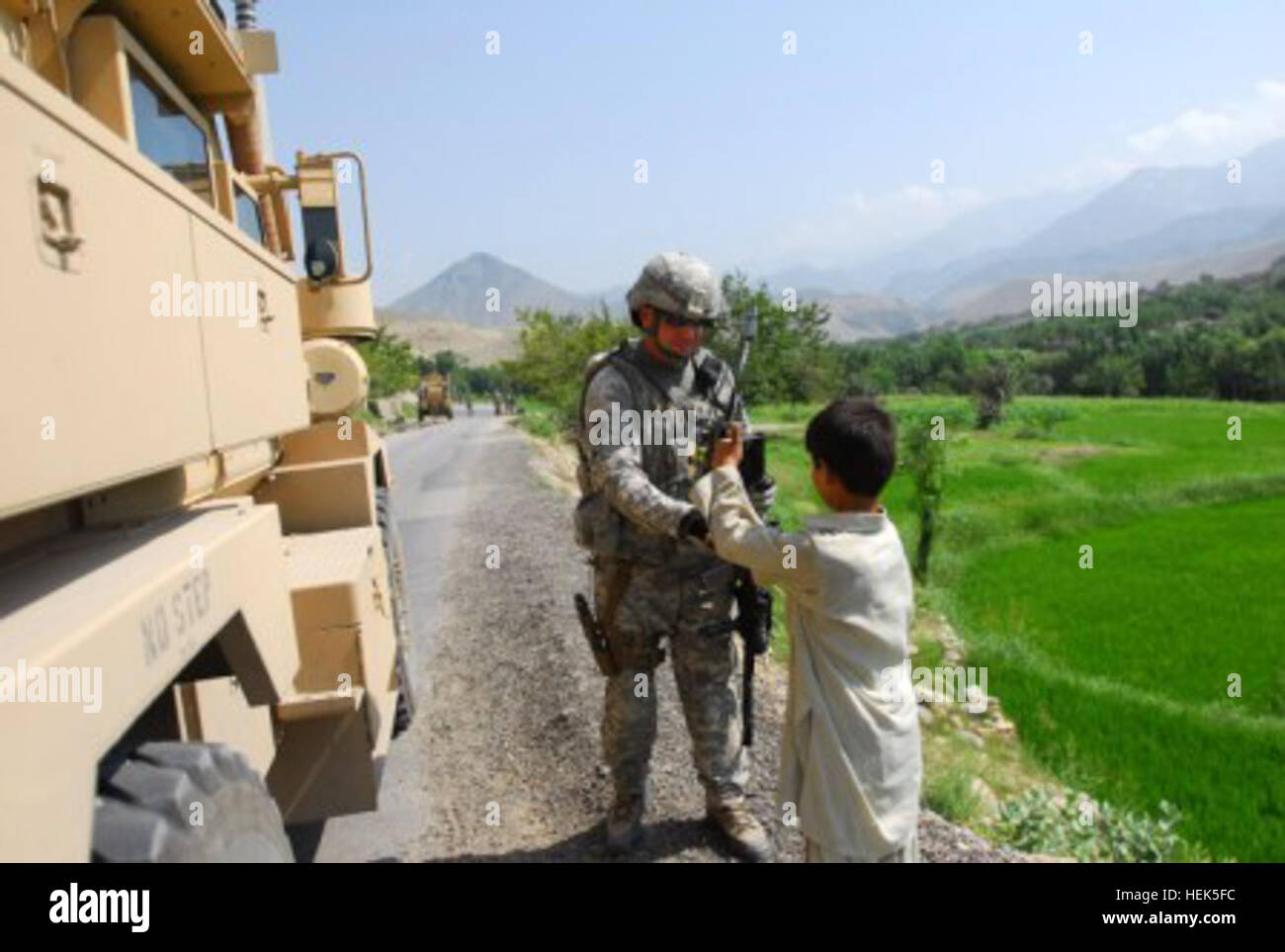 Staff Sgt. Joey Evans of Johnsonville, S.C., Security Force, Nuristan Provincial Reconstruction Team, talks with Stock Photo