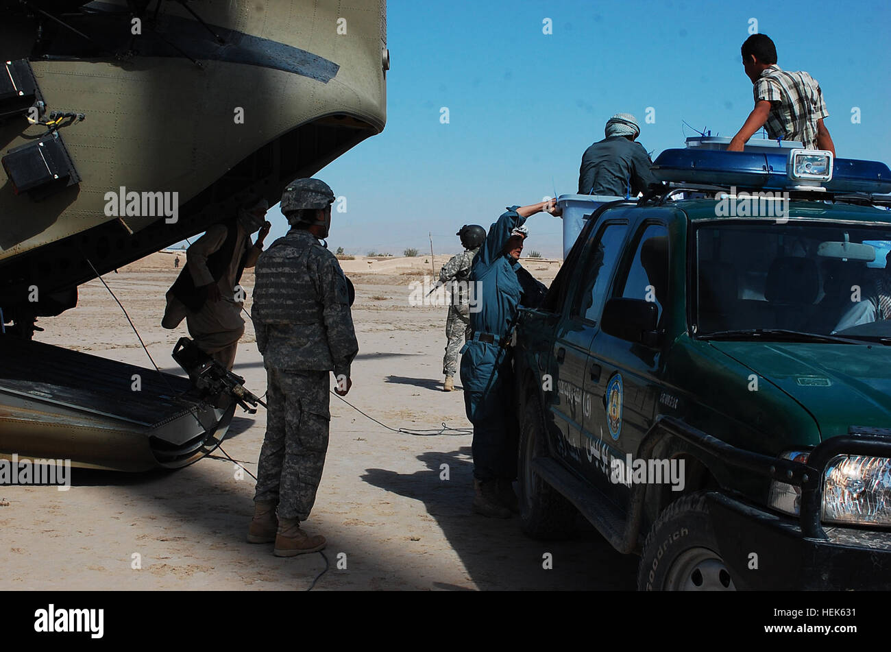 Members of the International Election Committee and Afghanistan National Police load sealed boxes containing ballots - Stock Image