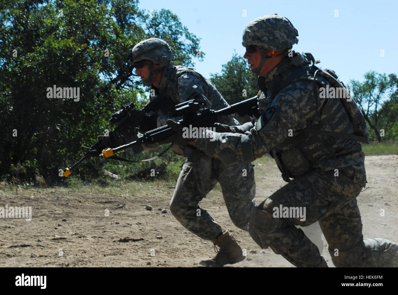 U.S. Army 1st Lt. Ross Cargile (left), a Round Rock, Texas, native and a fire direction officer with Bravo Battery, - Stock Image