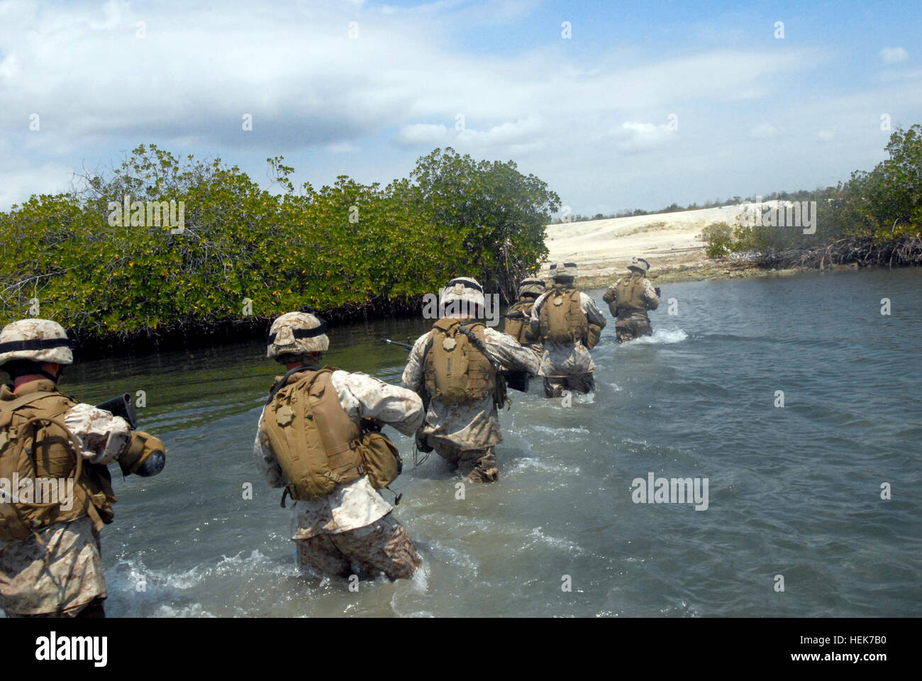 Marines wade through water after exiting a transportable port security boat at U.S. Naval Station Guantanamo Bay, Stock Photo