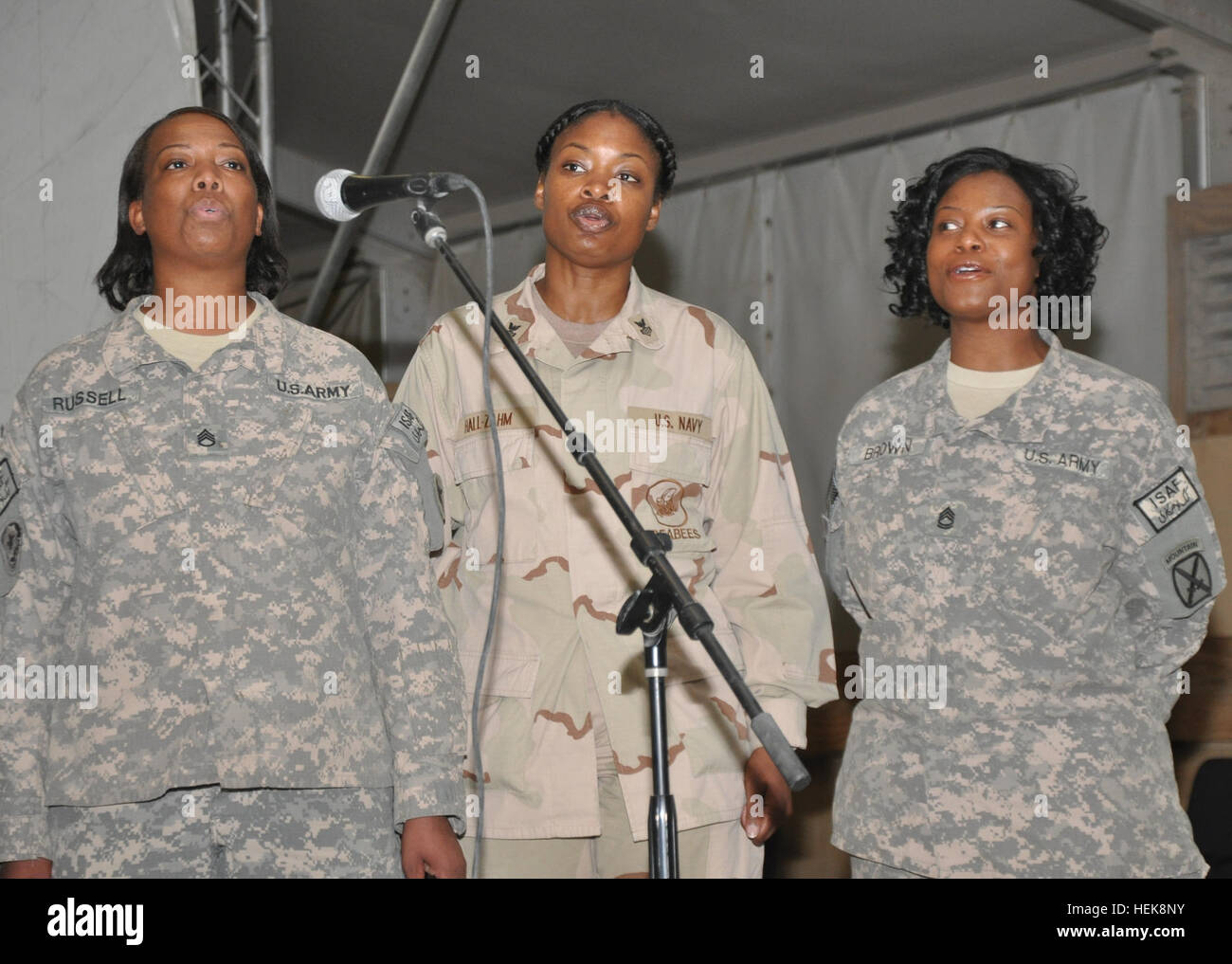 (From left) U.S. Army Staff Sgt. Cecilia Russell, Joint Sustainment Command - Afghanistan, U.S. Navy Logistics Support Stock Photo