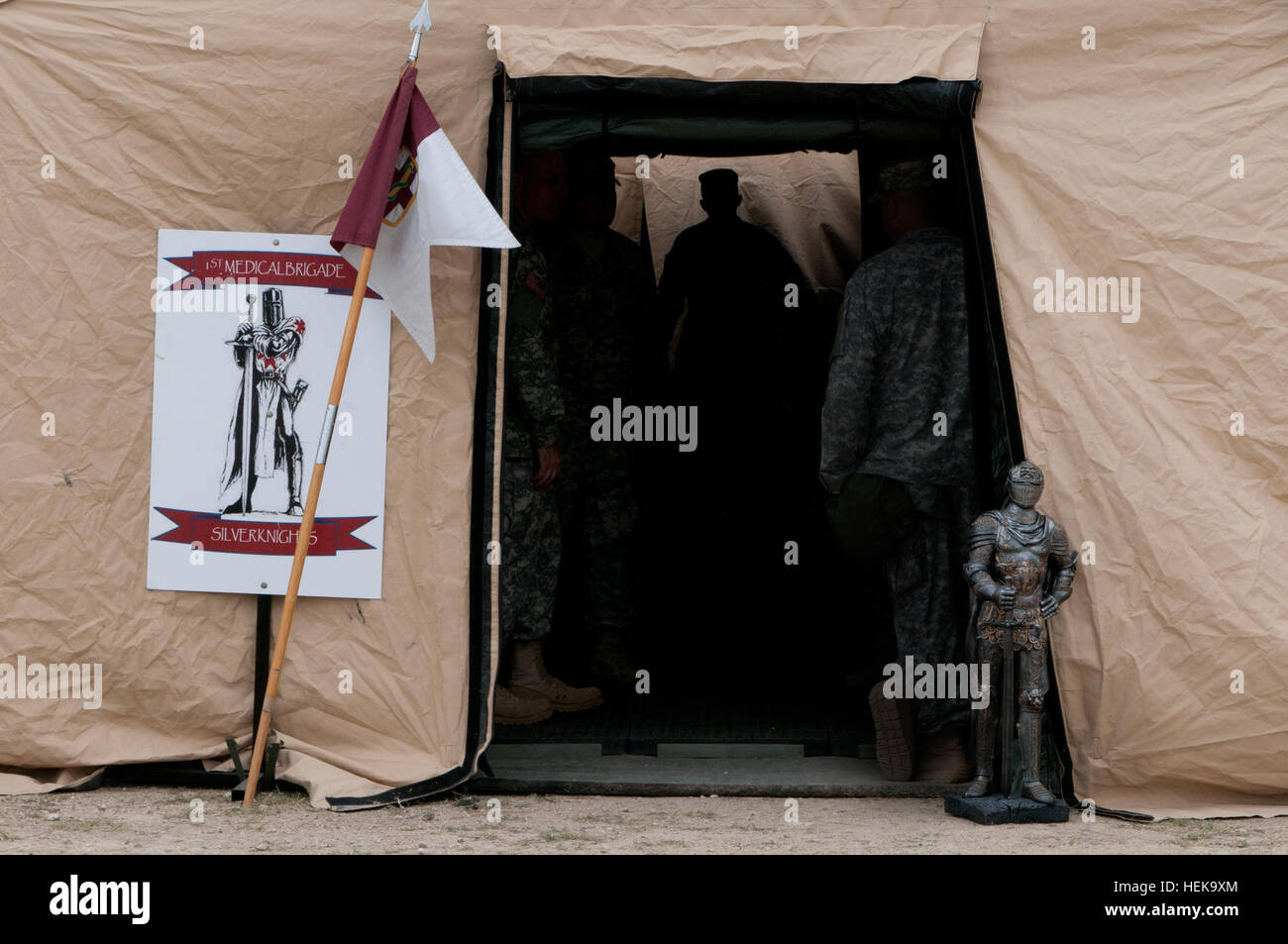 The 1st Medical Brigade's mascot, the Silver Knight, stands sentinel outside the tactical operations center - Stock Image