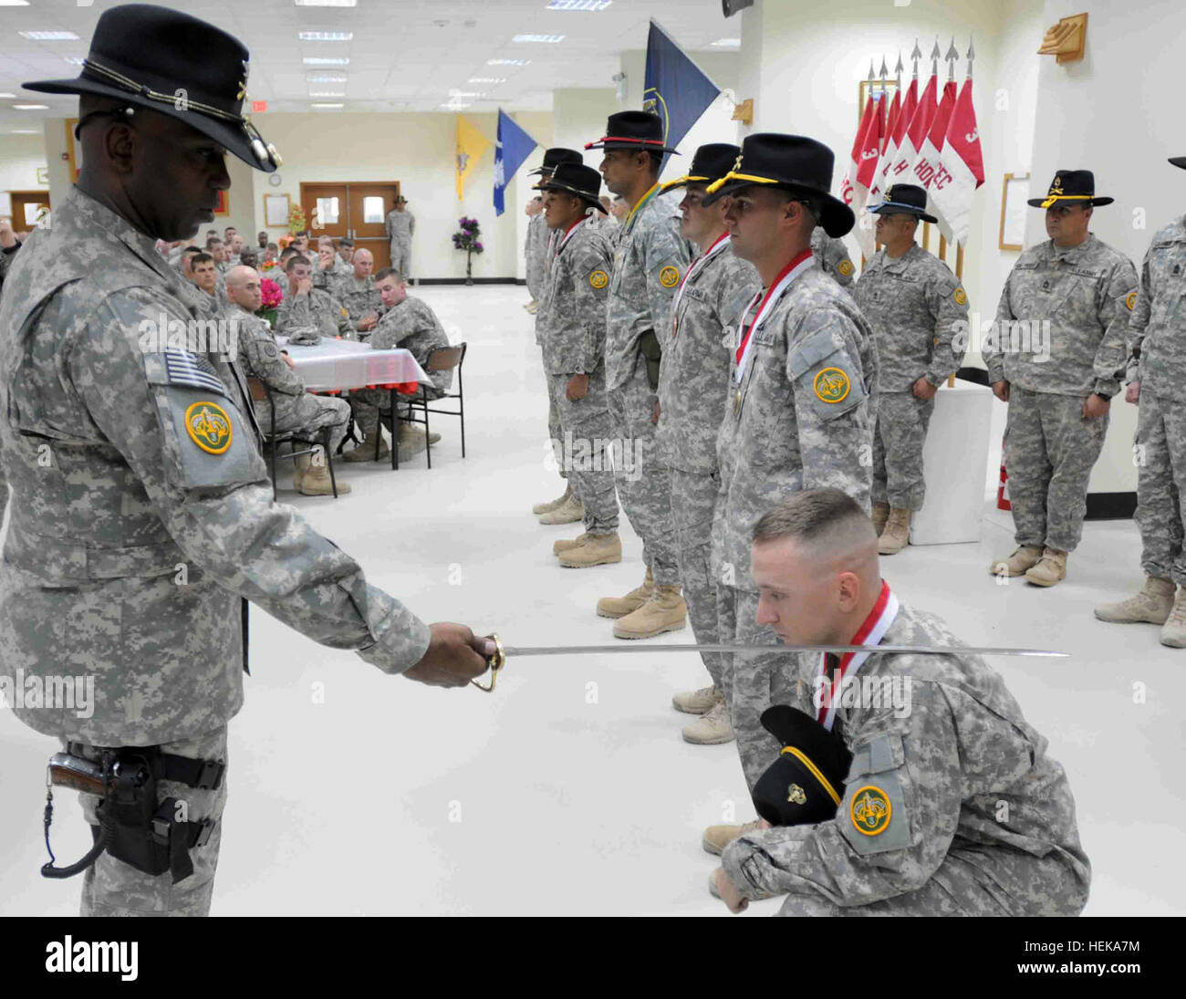WASIT, Iraq – Col. Reginald E. Allen, commander of the 3rd Armored Cavalry Regiment knights a newly awarded trooper Stock Photo