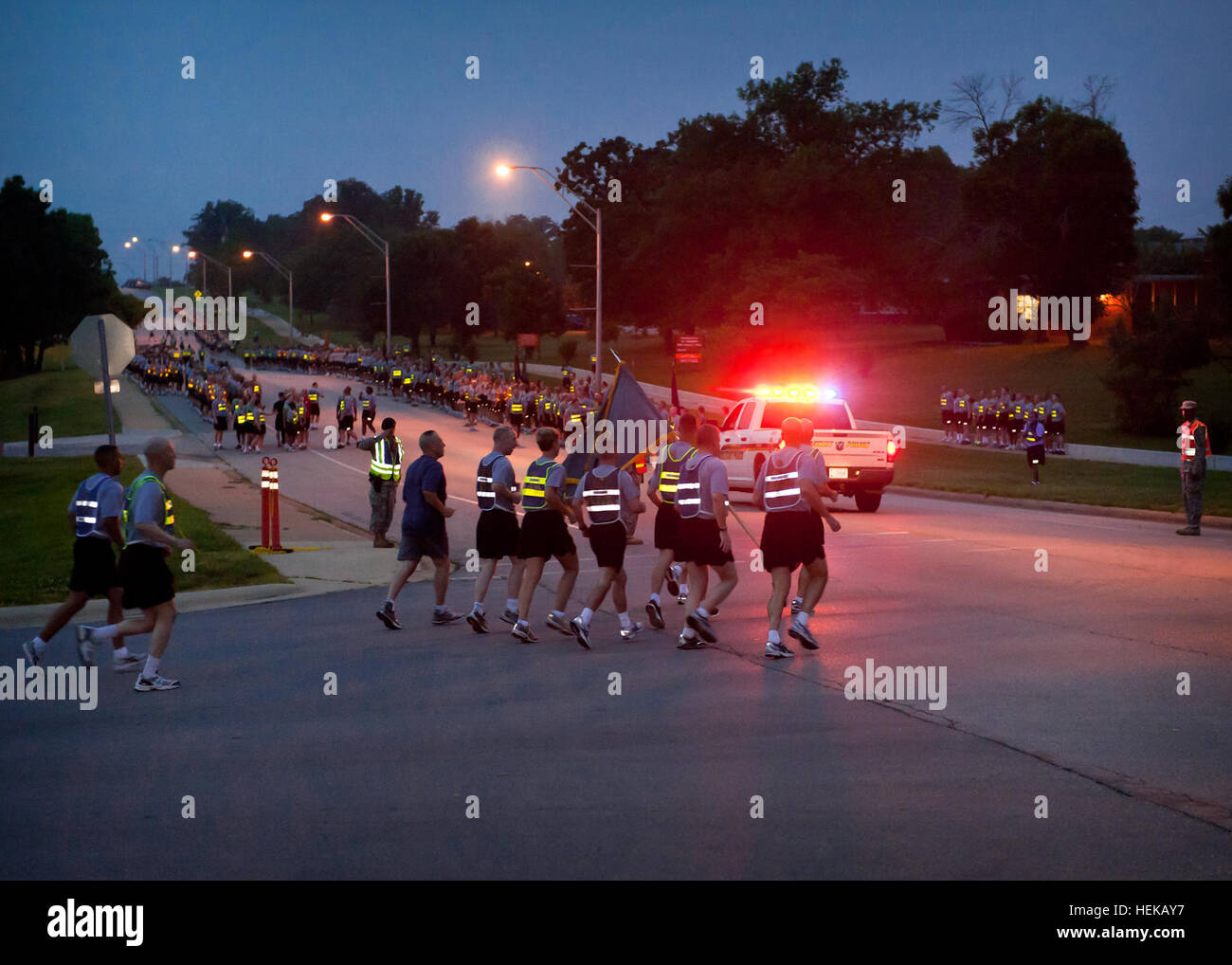 Military police escorted runners for the division style run, held June 14, 2011, on Fort Leonard Wood, Mo., in celebration - Stock Image