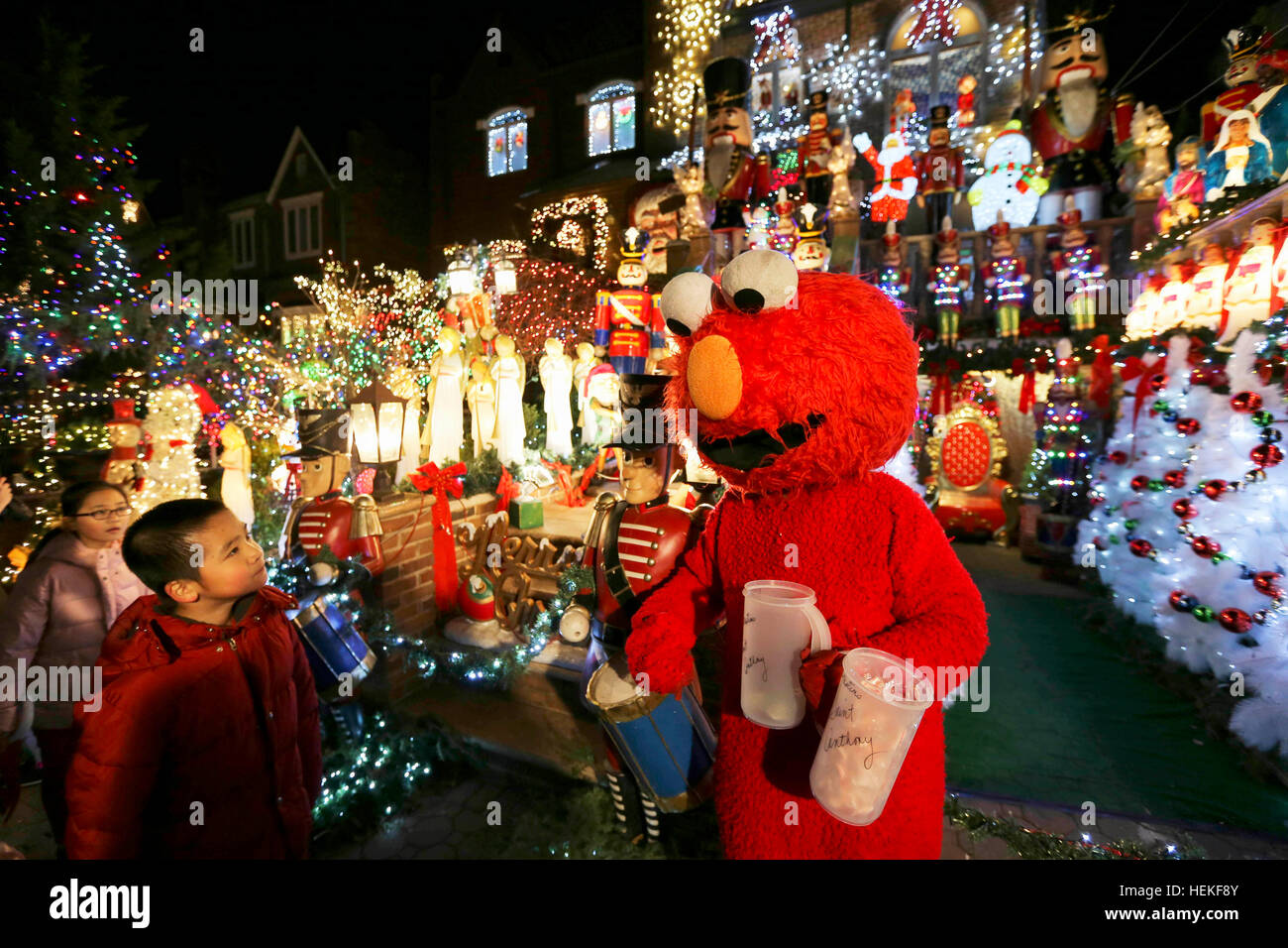 children visit a block with christmas decorations in dyker heights of brooklyn new york the united states dec 21 2016 every year after thanksgiving