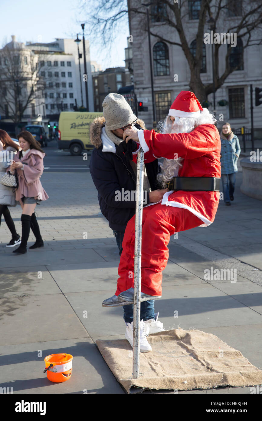 London, UK. 22nd Dec, 2016. Santa is helped into his costume in Trafalgar Square London © Keith Larby/Alamy - Stock Image