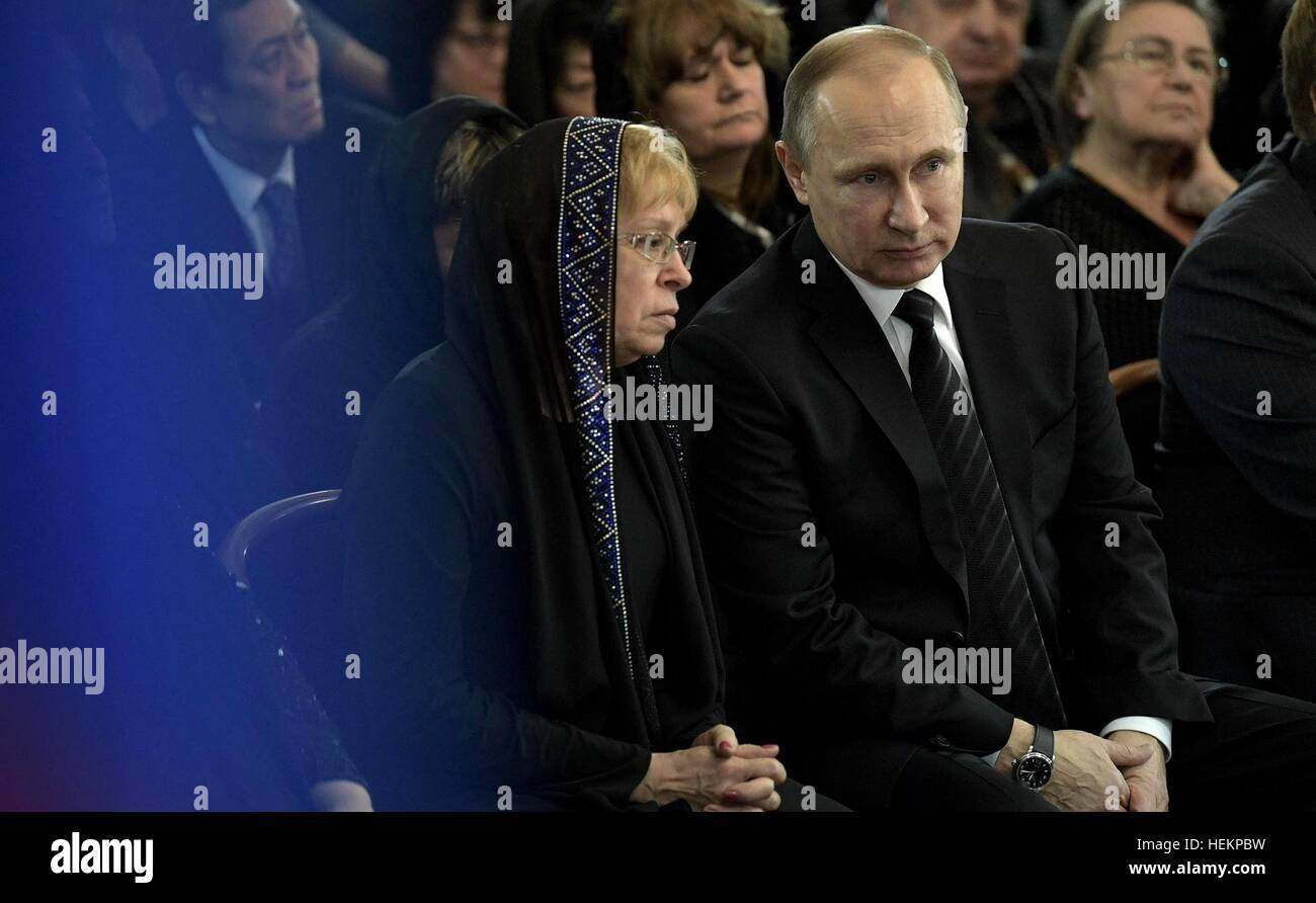 Moscow, Russia. 22nd Dec, 2016. Russian President Vladimir Putin sits with Marina Karlov, widow of Russian Ambassador - Stock Image