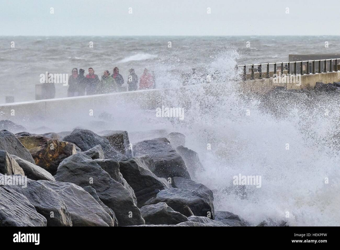 West Bay, Dorset, UK. 23rd Dec, 2016. Weather. Storm watchers get a soaking in West Bay as storm Barbara hits the - Stock Image
