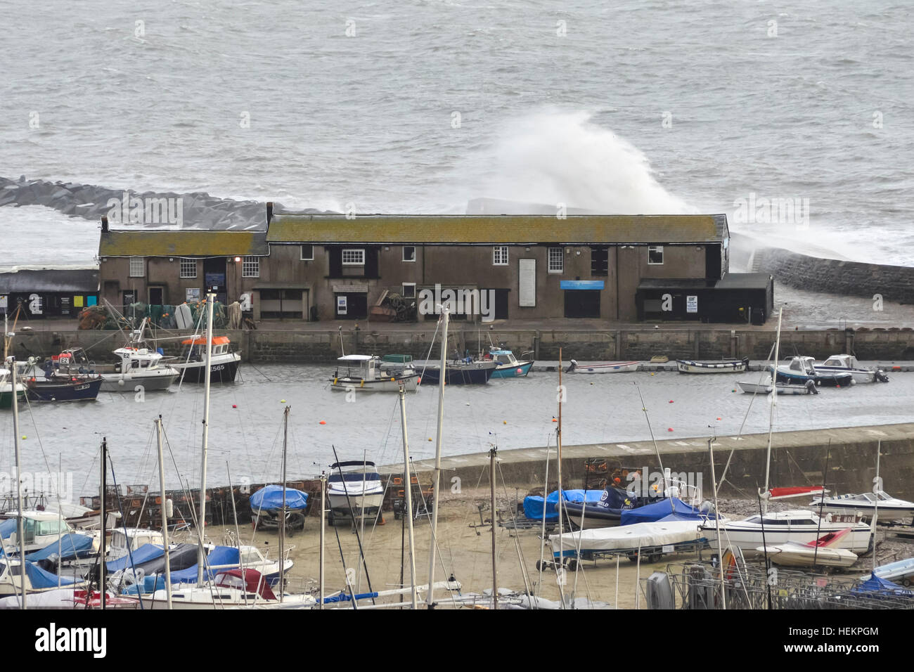 Lyme Regis, Dorset, UK. 23rd Dec, 2016. Weather. Large waves crash against the historic Cobb Harbour wall at Lyme Stock Photo