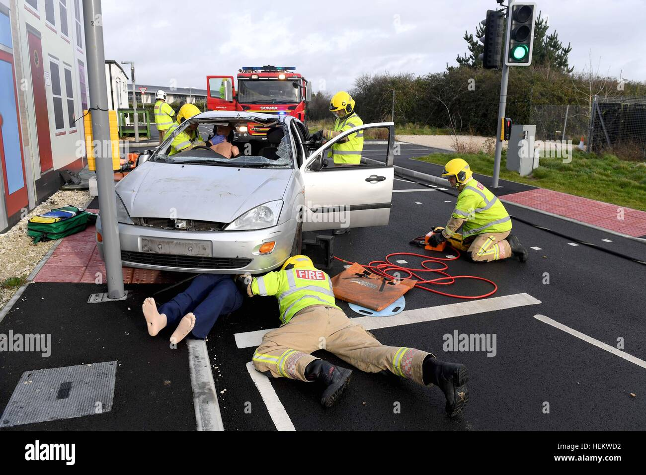 "Firefighters working at the scene of an accident demonstration, UK. ""Car crash"" scene, RTA or RTC, Crashed car with Stock Photo"