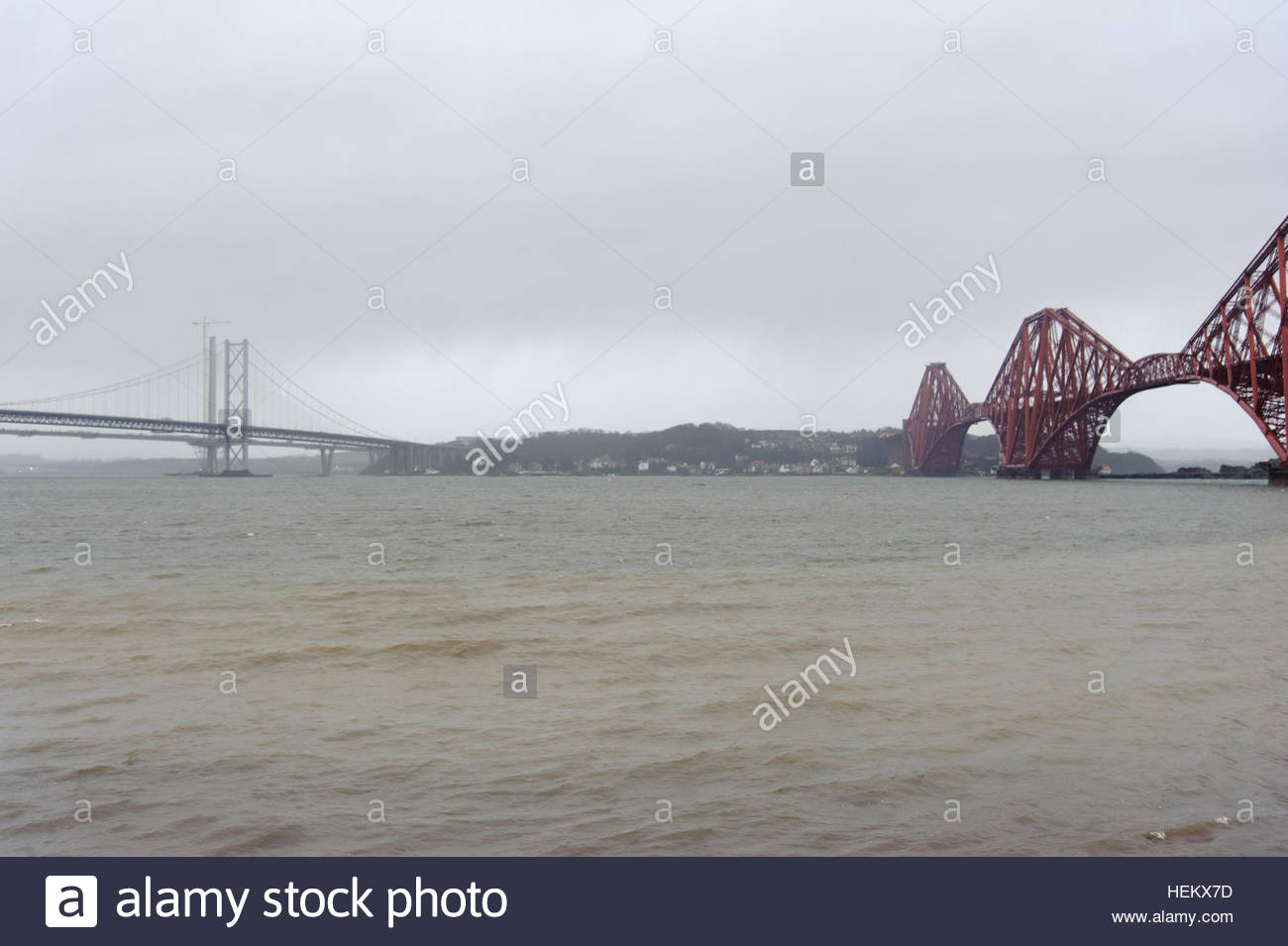 South Queensferry, UK. 24 December, 2016. UK Weather.   Dark skies over the bridges as Storm Barbara makes her final - Stock Image
