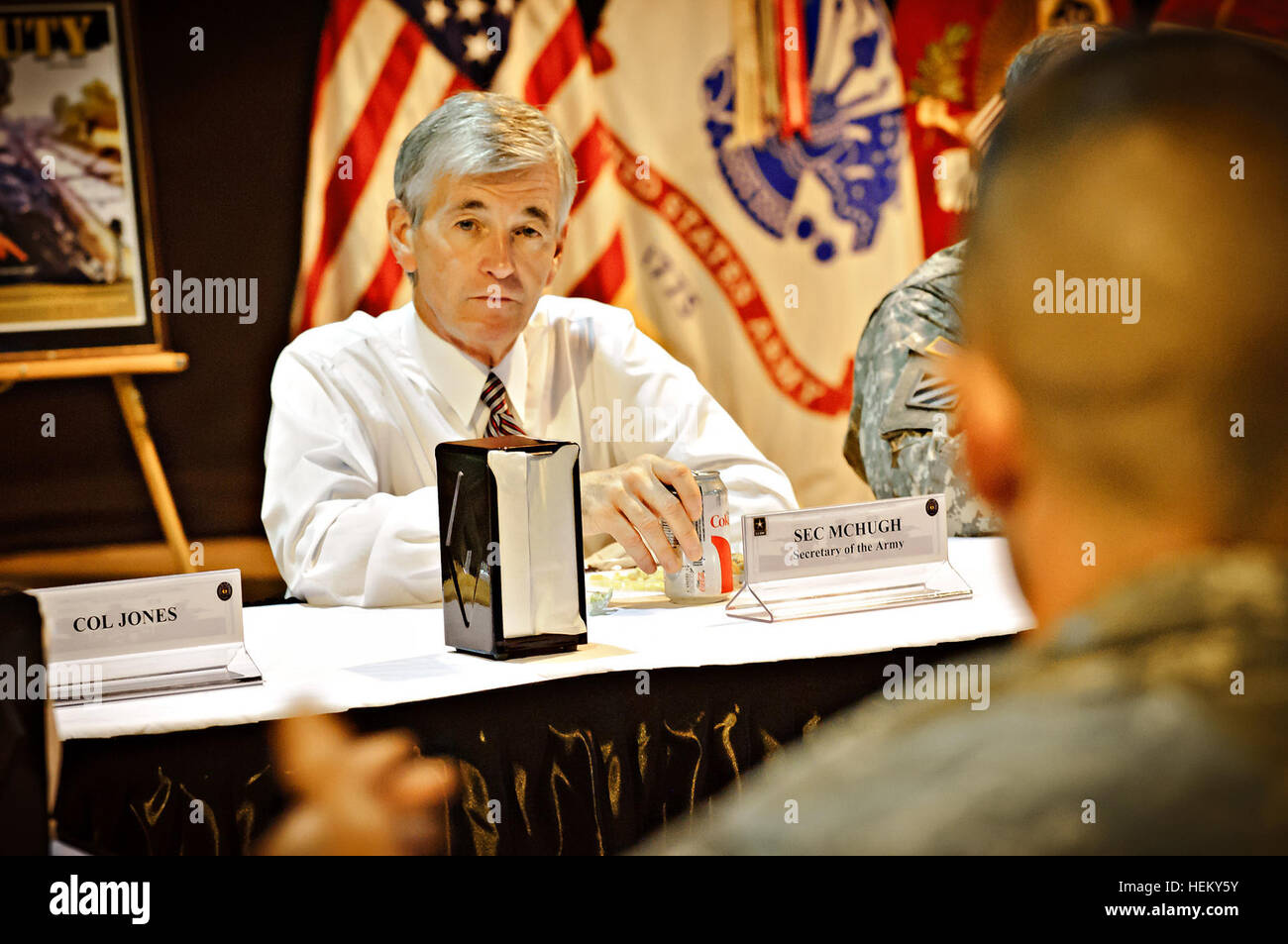 The honorable John McHugh the 21st United States Secretary of the Army listens to soldiers competing in the 2011 Stock Photo