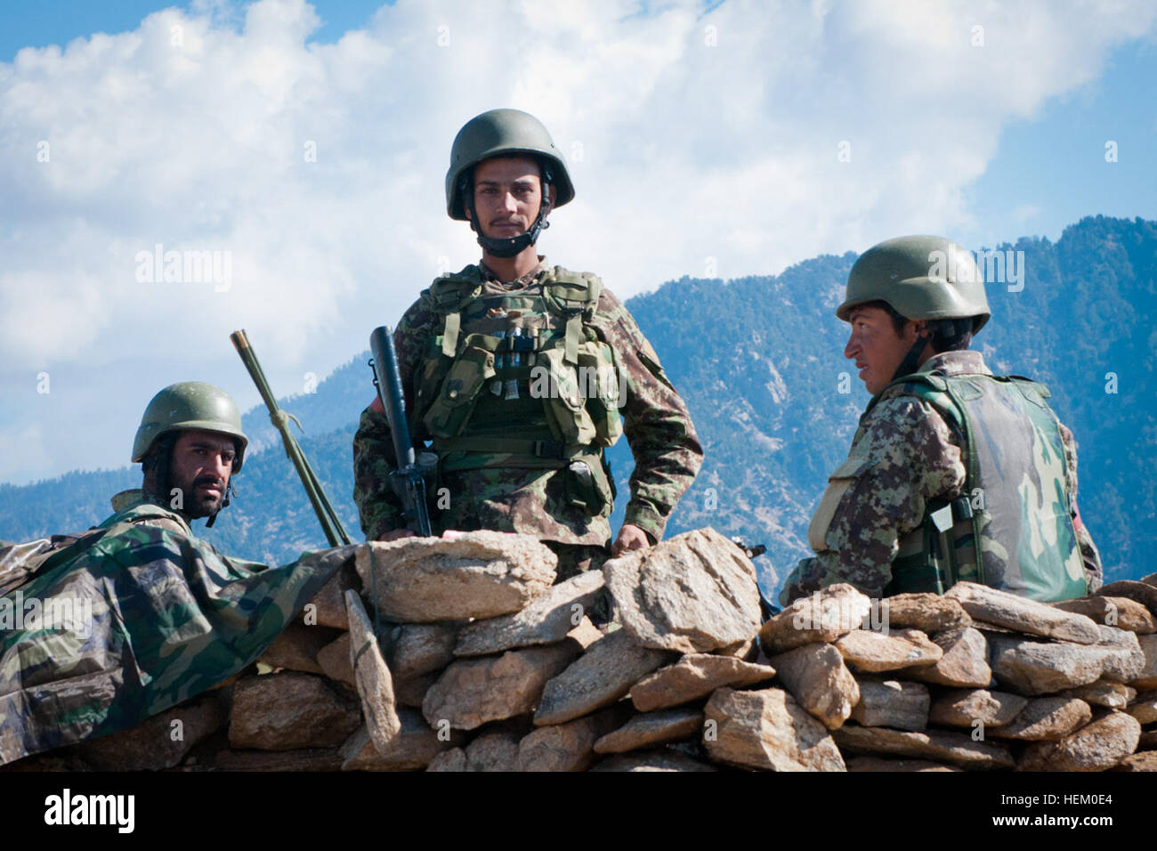 An Afghan National Army soldier poses while his comrades look on in the Dawlat Shah district Nov. 15.  The ANA was - Stock Image