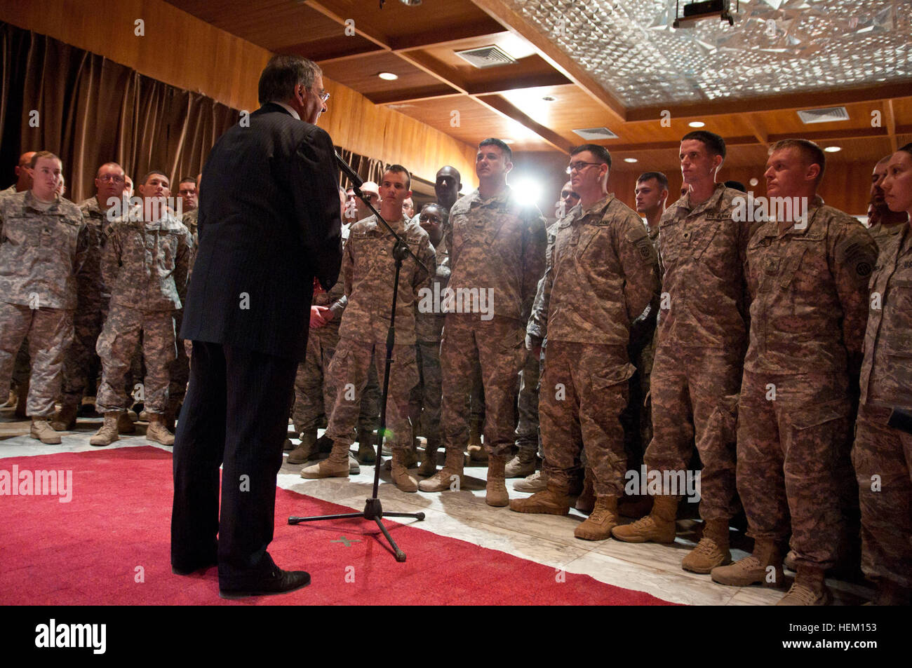 Secretary of Defense Leon Panetta talks with U.S. service members following the end of mission ceremony that marked - Stock Image