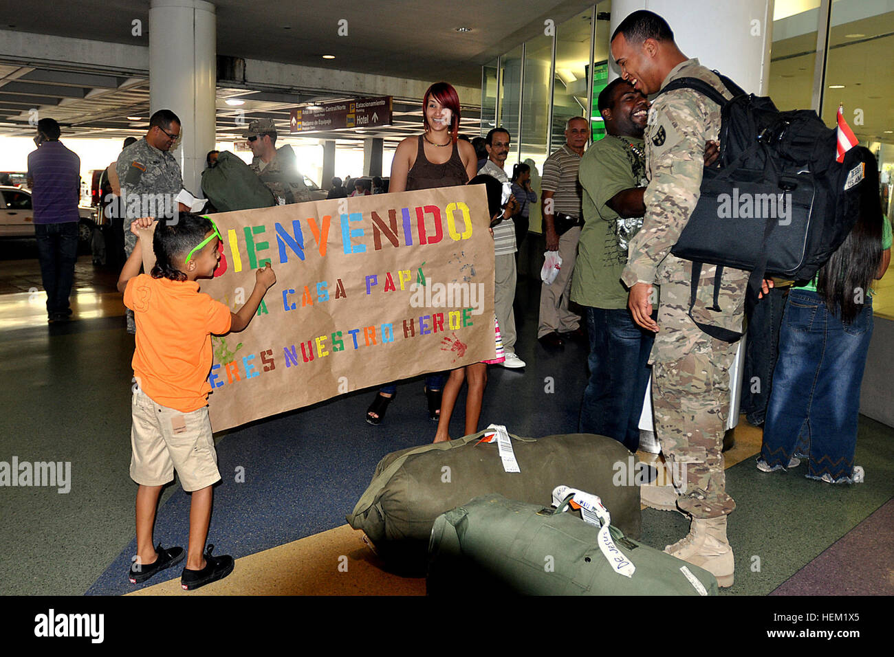 Spc. Orlando De Jesus, of the Puerto Rico Army National Guard 130th Engineer Battalion, reads the banner prepared - Stock Image