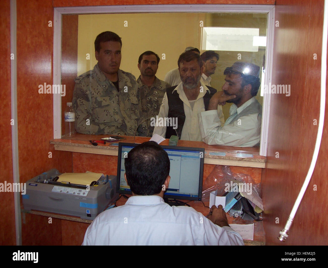 Afghan National Police use the services at the newly opened New Kabul Bank located at the Joint Regional Afghan - Stock Image
