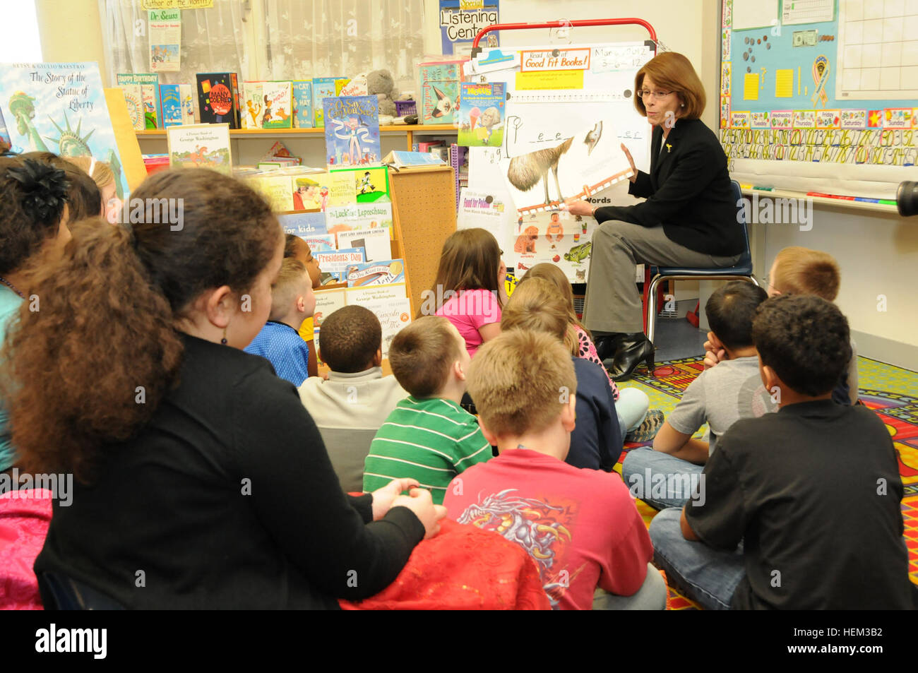 Jeanne Chandler, wife of Sgt. Maj. of the Army Raymond F. Chandler III, reads to multi-aged students at the Rose Stock Photo
