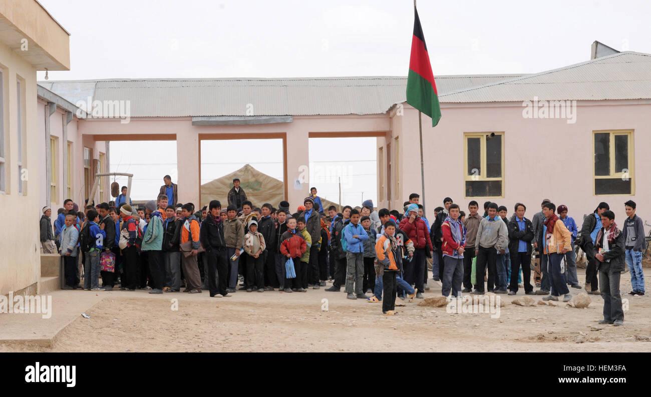 Young Afghan boys stand outside of the Aliabad School near Mazar-e-Sharif, Afghanistan, March 10, 2012. Their new - Stock Image