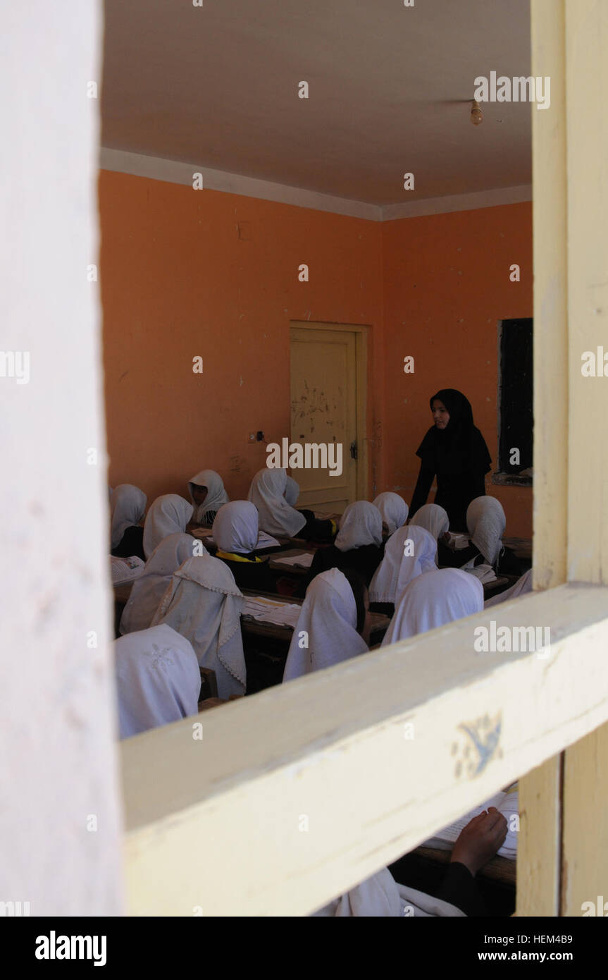 Afghan girls receive a lesson from their teacher at the Aliabad School near Mazar-e-Sharif, Balkh province, Afghanistan, - Stock Image