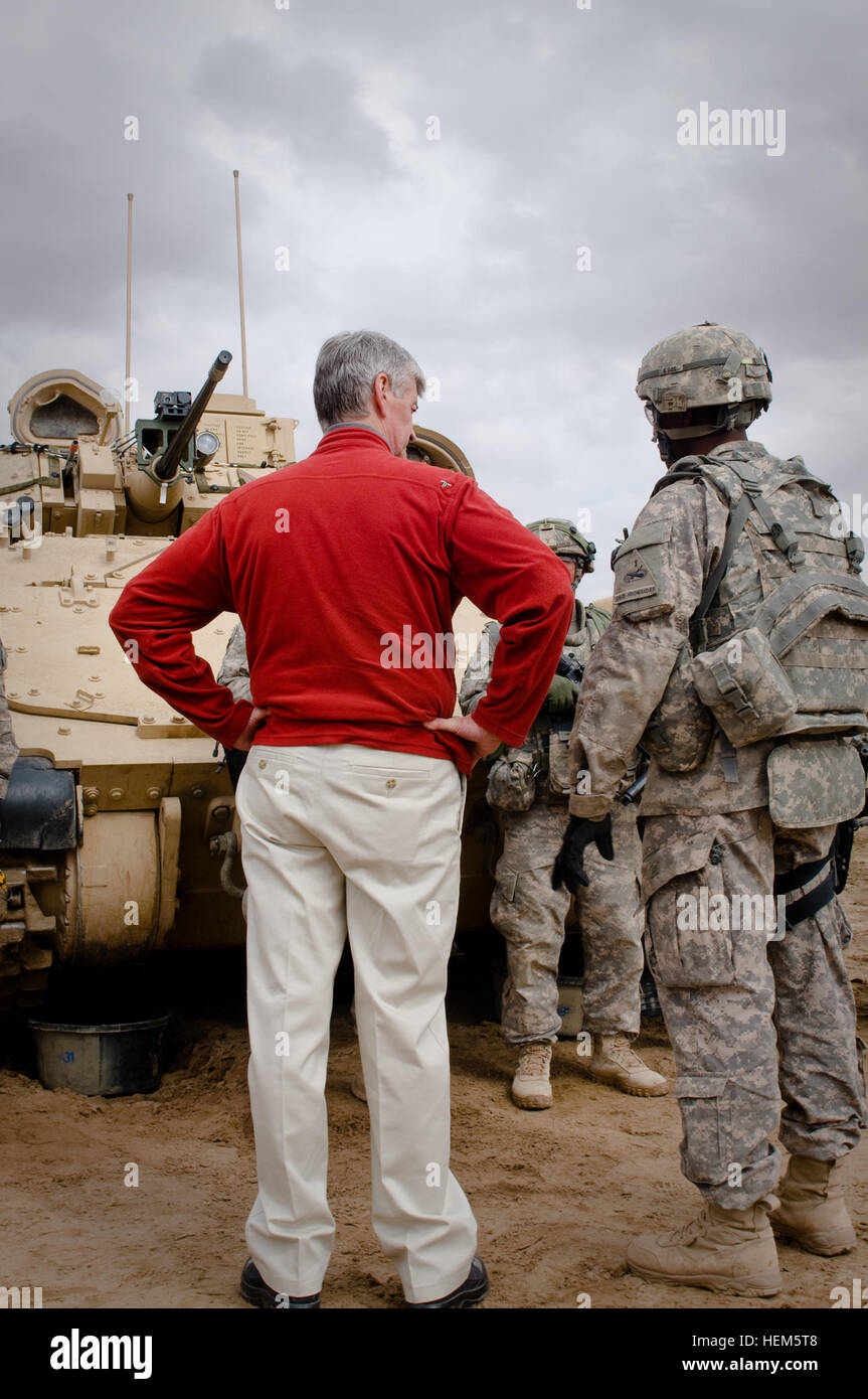 Secretary John McHugh, the 21st secretary of the Army, stands next to a Bradley Tank, while talking with a 2nd Heavy Stock Photo