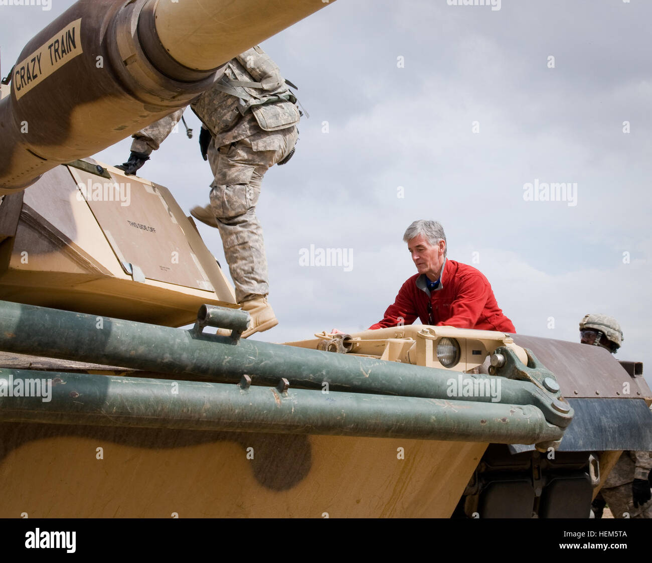 Secretary John McHugh, the 21st secretary of the Army, climbs onto an Abrams Tank, while visiting 2nd Heavy Brigade Stock Photo