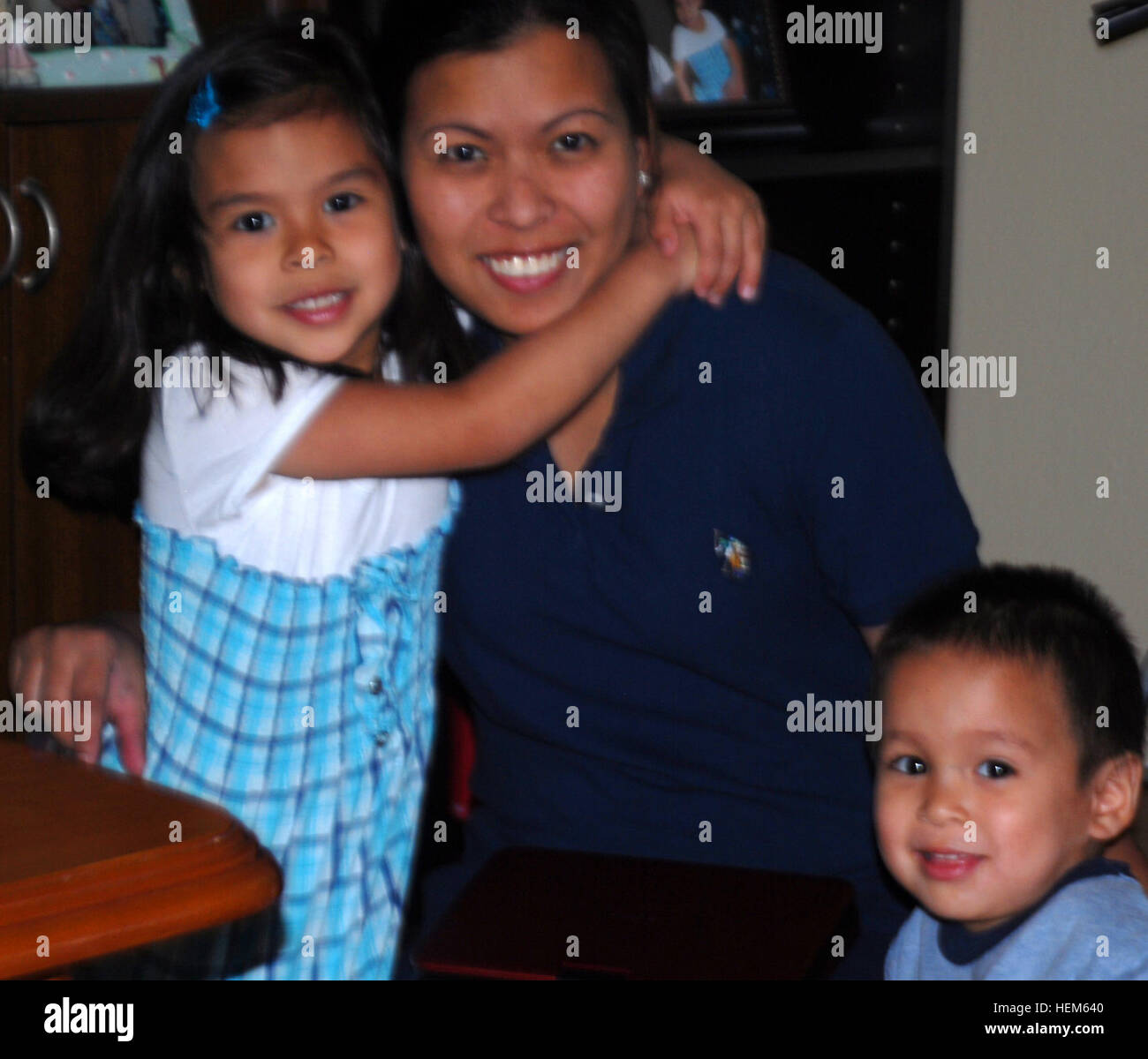 Melit Rodriquez takes care of her children Denise, 4, and Fausto Jr., 2, on Mother's Day, May 13, 2012 at their - Stock Image