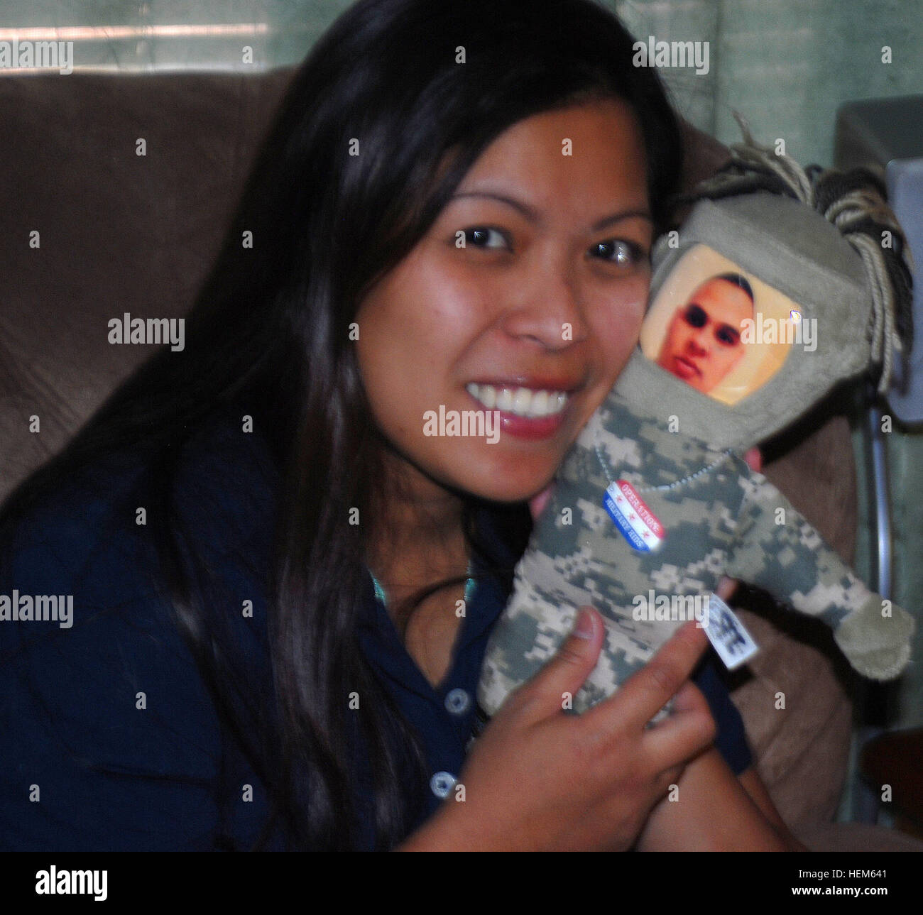 Melit Rodriquez hugs one of her children's favorite toys a 'daddy doll,' May 13, 2012. Rodriquez says - Stock Image
