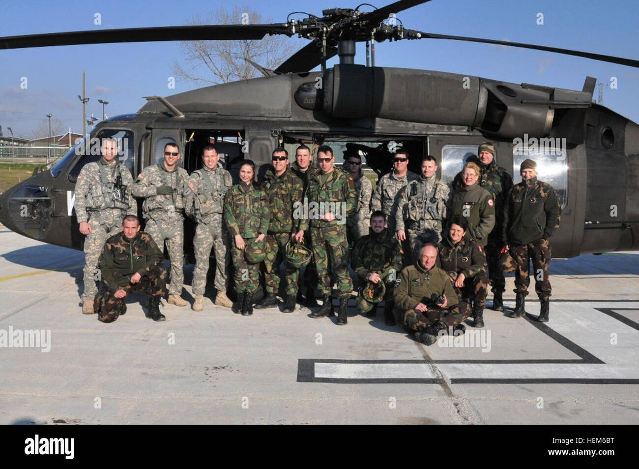 U.S. Army soldiers with the Louisiana National Guard's 2nd Battalion, 244th Aviation Regiment, pose with Hungarian Stock Photo