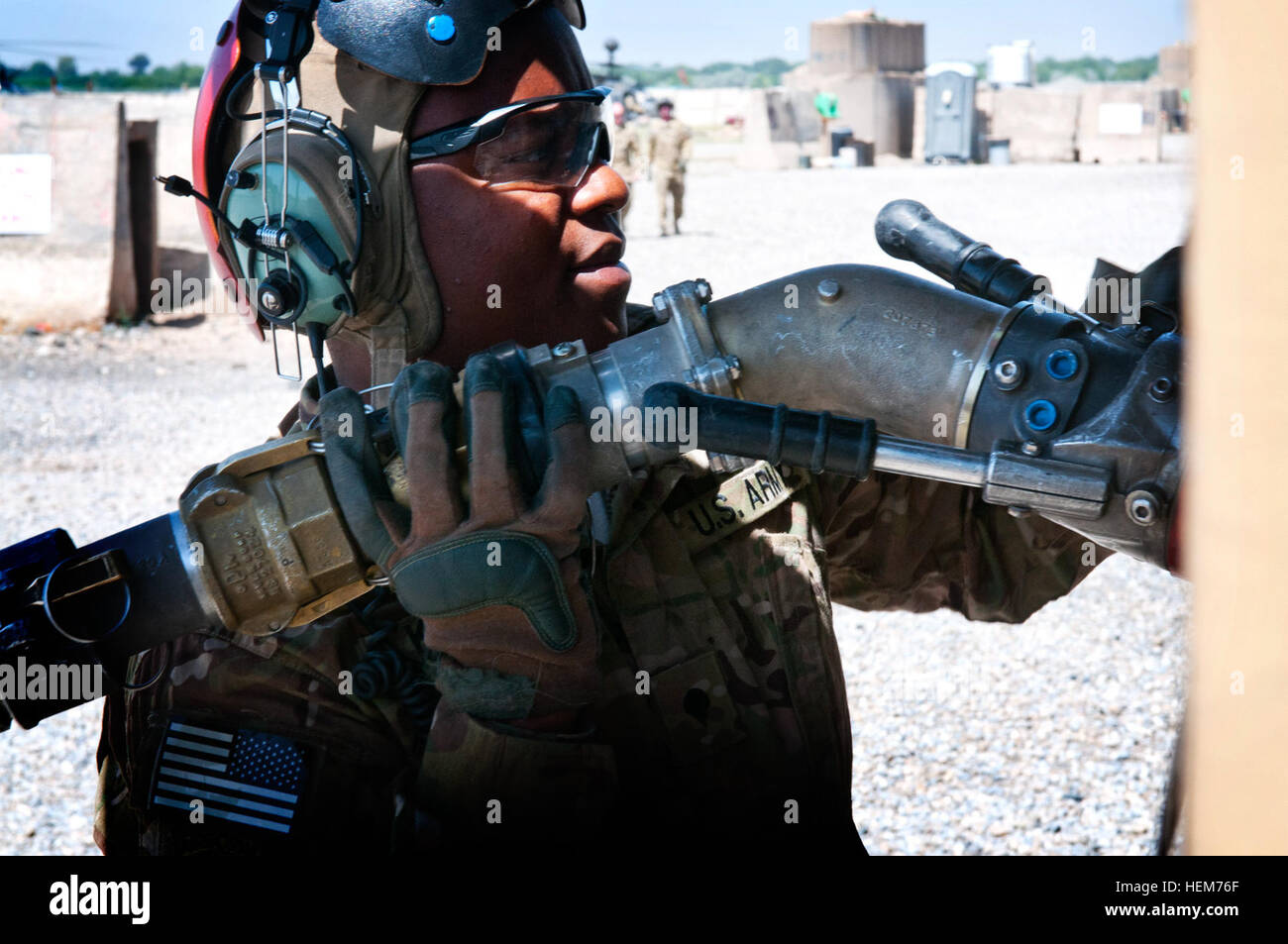 Spc. Alfred Kollie, a petroleum supply specialist with Task Force Wolfpack, 82nd Combat Aviation Brigade, checks - Stock Image