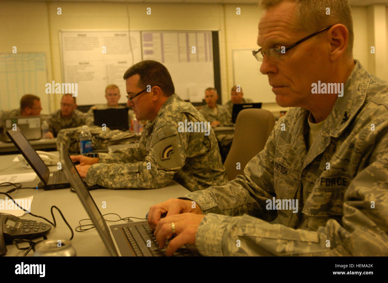 Air National Guard Col. Walter Wintsch and New York National Guard Col. Dennis Deely work together in the operations - Stock Image