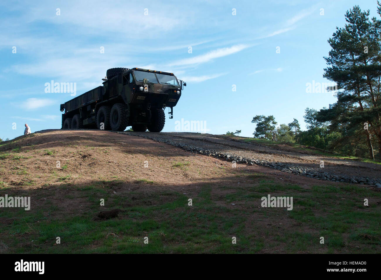 Soldiers drive a Heavy Expanded Mobility Tactical Truck, or HEMTT, during a run-through of an obstacle on the new Stock Photo