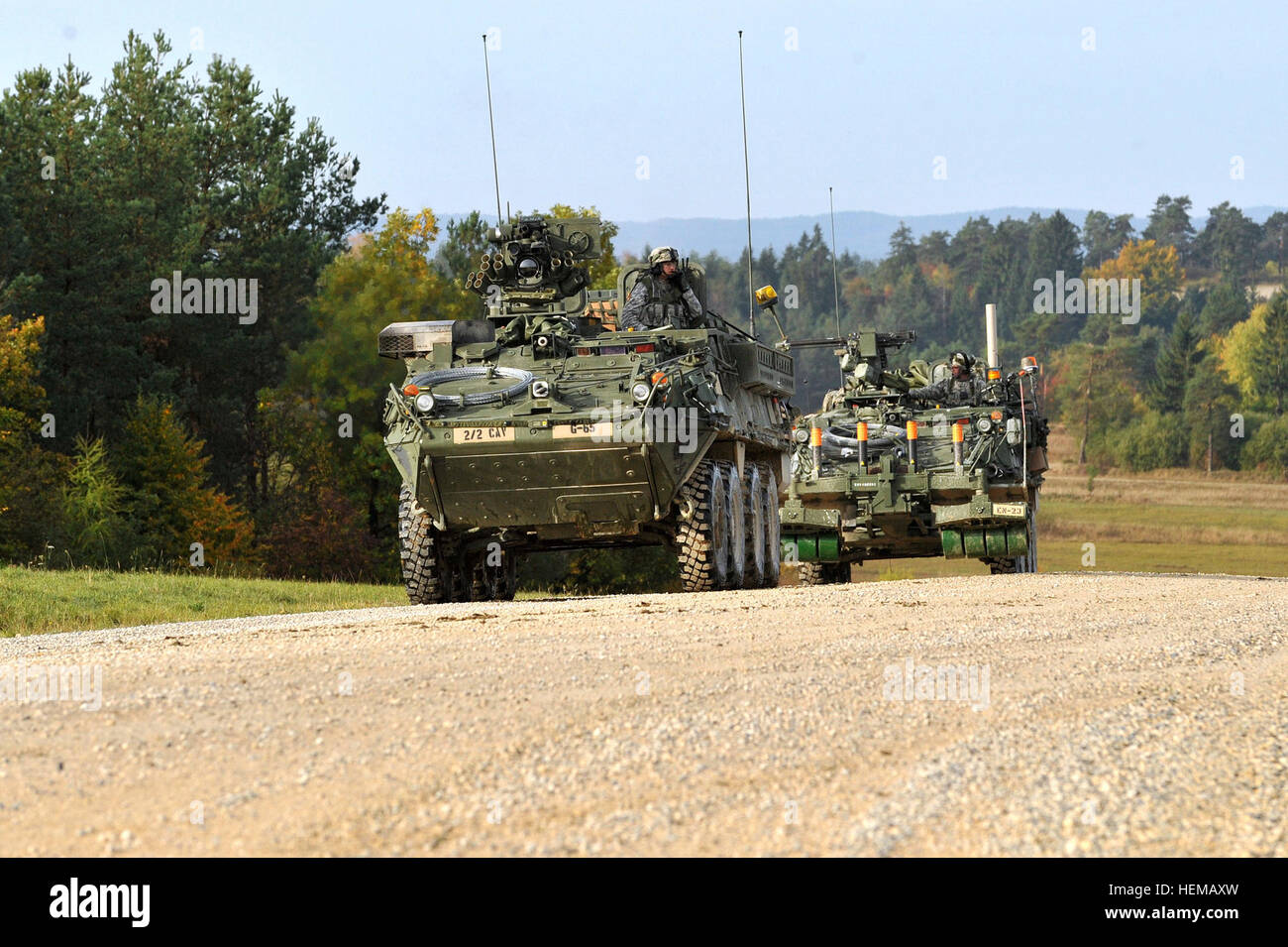 Two Stryker combat vehicles convoy along a  tank trail during Saber Junction 2012 at Grafenwoehr Training Area, - Stock Image