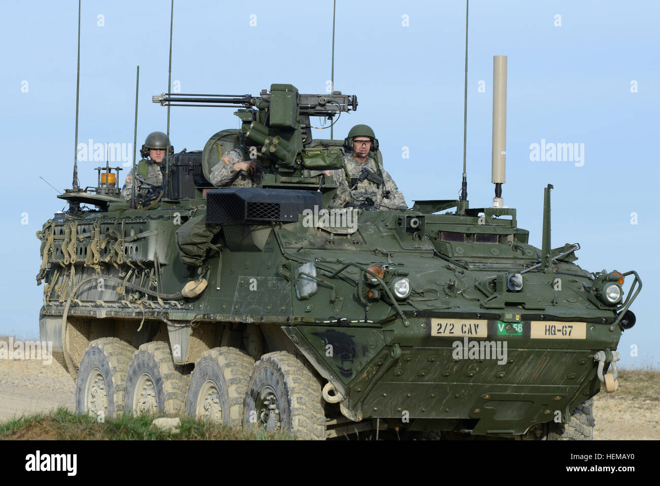 U.S. Army Europe Command Sgt. Maj. Christopher Spivey (right), assigned to 2nd Squadron, 2nd Cavalry Regiment, navigates - Stock Image