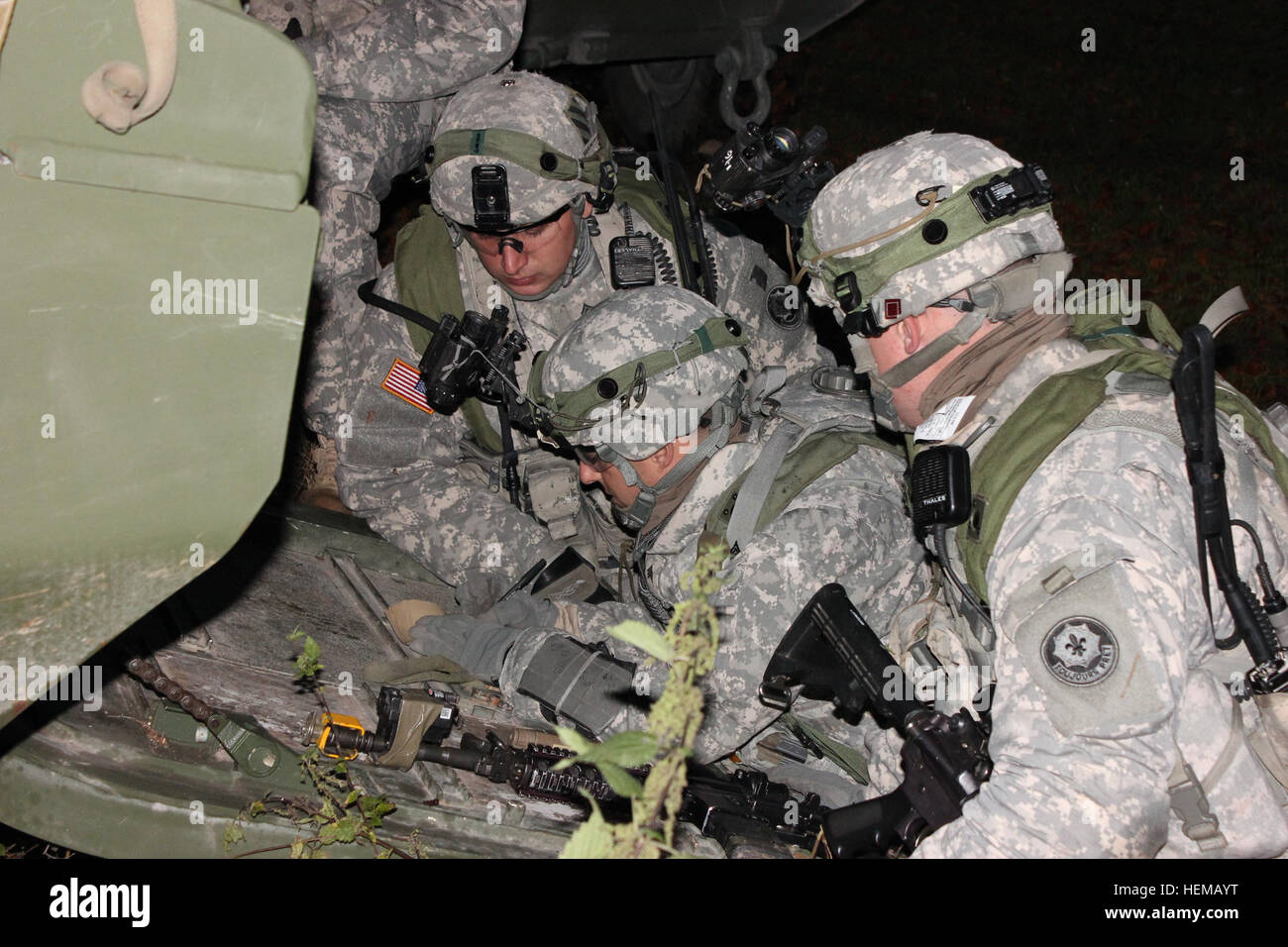 U.S. Army Soldiers of Comanche Troop, 1st Squadron, 2nd Cavalry Regiment plan convoy routes during a decisive action - Stock Image