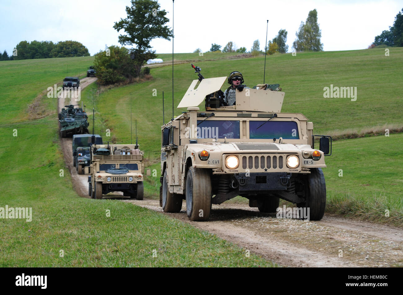 U.S. Army Europe's 4th Squadron, 2nd Cavalry Regiment, move through the German country side towards the village - Stock Image