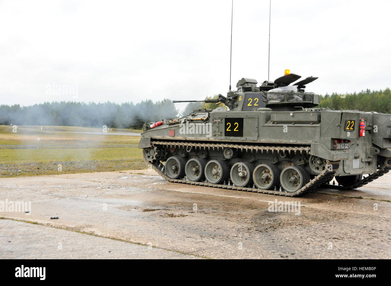 The United Kingdom's Bravo Company of the 3rd Mercian fires a 5-11 Warrior Infantry Fighting Vehicle ejecting a - Stock Image