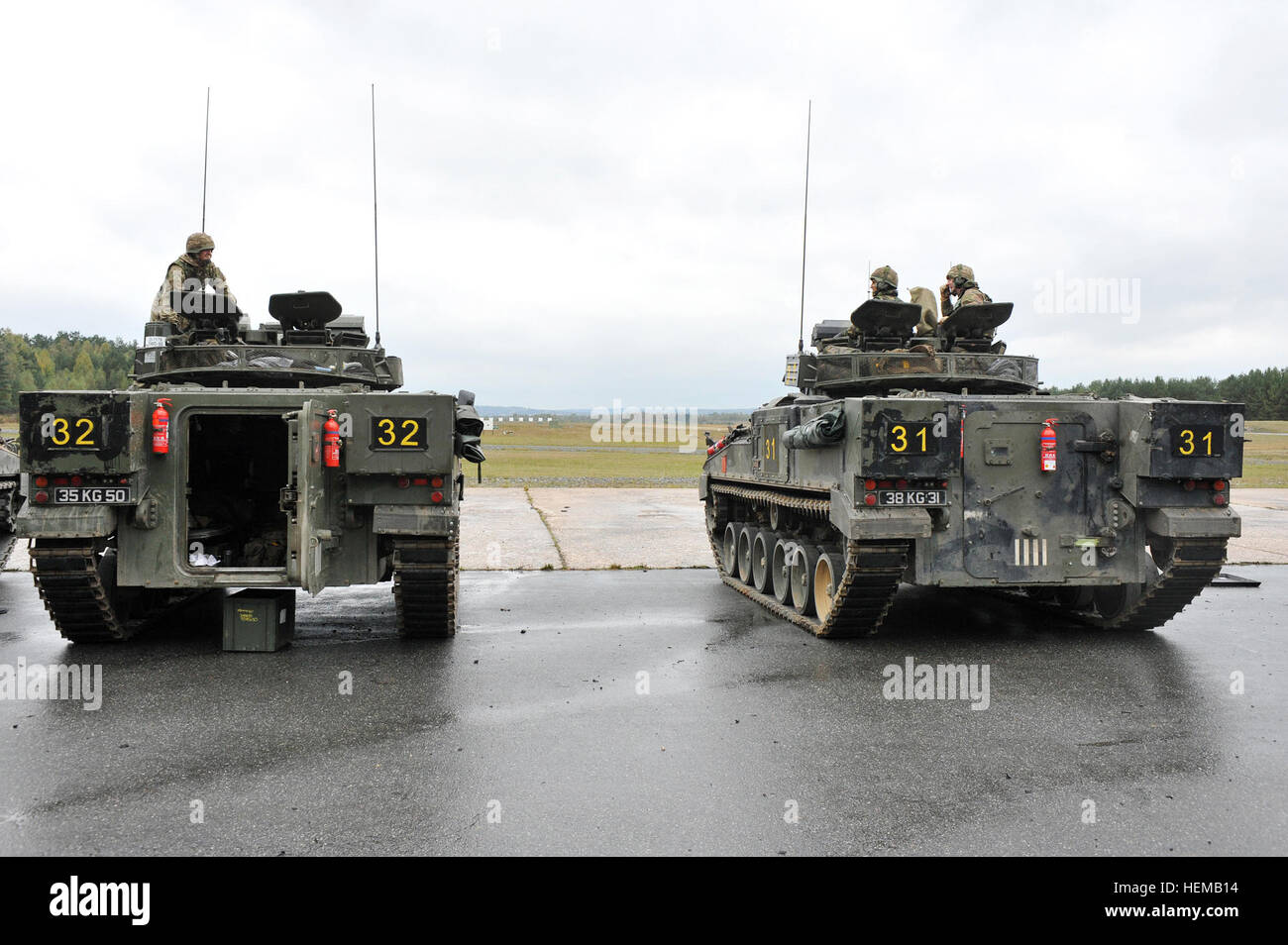 British Army soldiers assigned to Bravo Company, 3rd Mercian, line up their Warrior Infantry Fighting Vehicles for - Stock Image