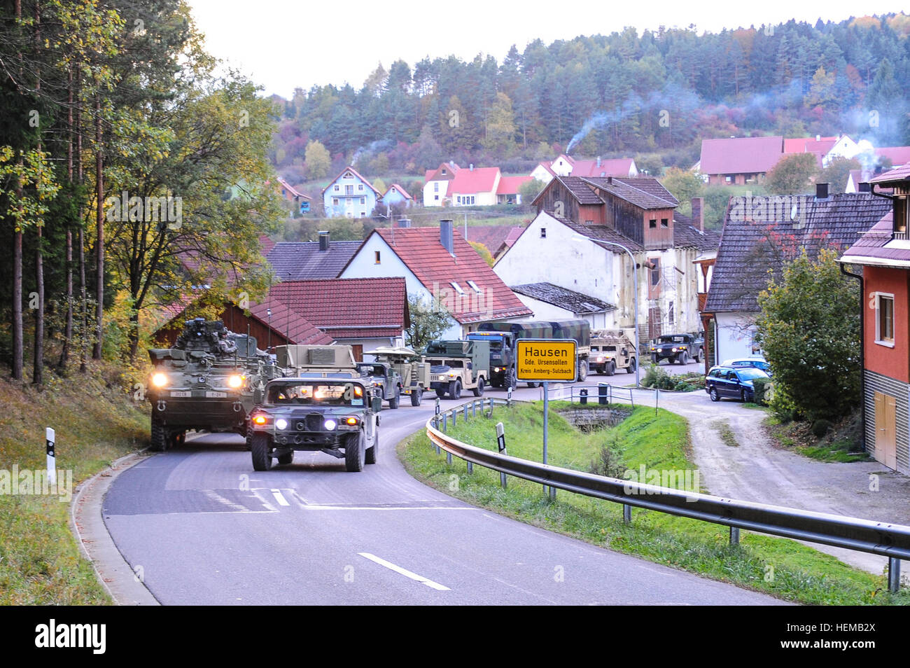 GRAFENWOEHR, Germany --  Vehicles, from U.S. Army Europe's 2nd Calvary Regiment, move through the German Village - Stock Image