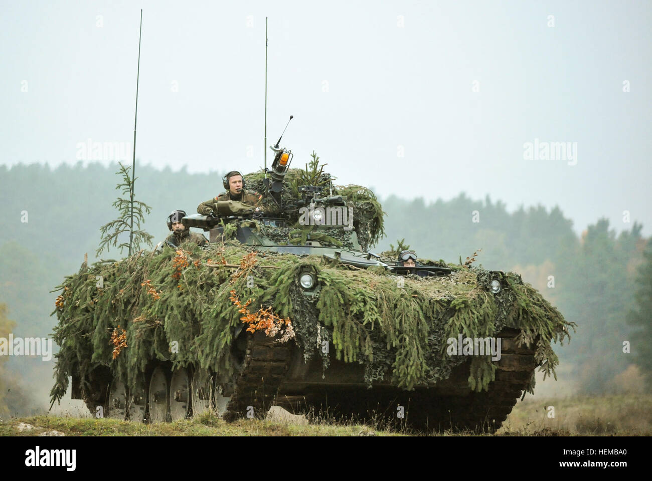 German Army Soldiers in a Marder infantry fighting vehicle scan the battlefield during Saber Junction 2012 at the - Stock Image