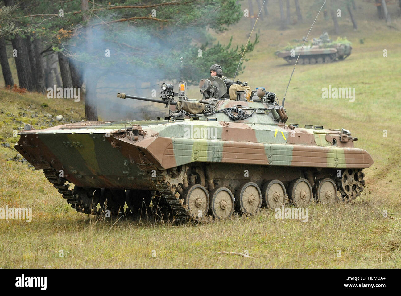Multinational opposing forces or 'OPFOR' vehicles move into a fighting position during Saber Junction 2012 - Stock Image