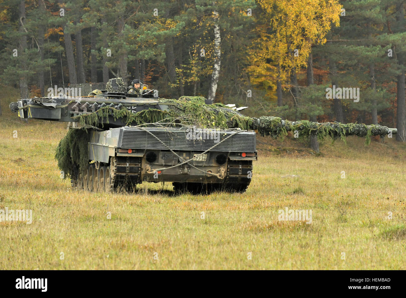 A German Army Leopard II tank assigned to the 104th Panzer Battalion, scans the battlefield at the Joint Multinational - Stock Image