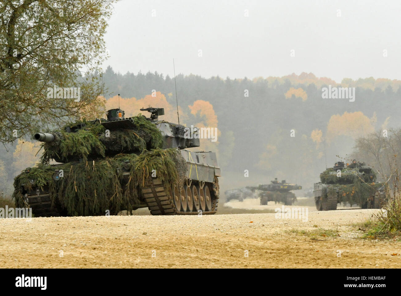German Army Leopard II tanks assigned to the 104th Panzer Battalion, move through the Joint Multinational Readiness - Stock Image