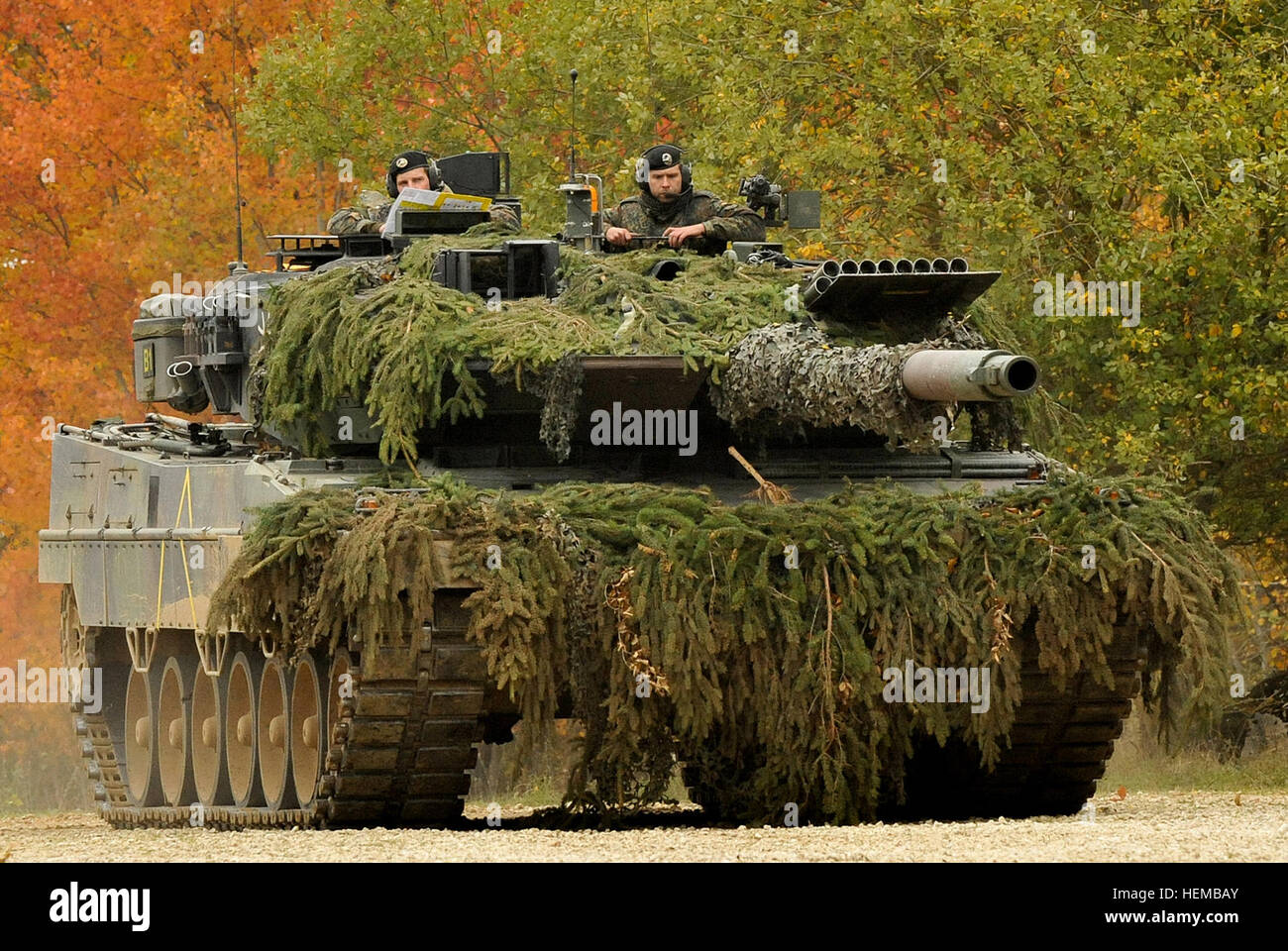 A German Army Leopard II tank, assigned to 104th Panzer Battalion, moves through the Joint Multinational Readiness - Stock Image