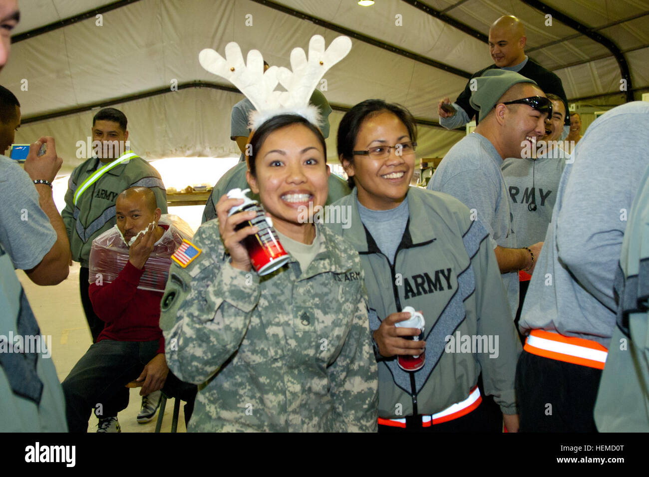 Deployed soldiers from the Hawaii National Guard celebrate Christmas at Camp Bondsteel, Kosovo, with a feast, games - Stock Image